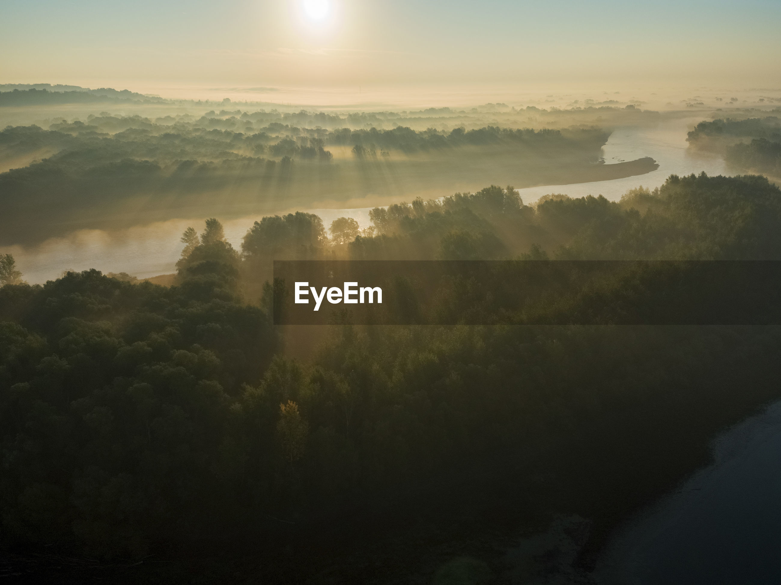 Aerial view of morning sunrise on the drava river