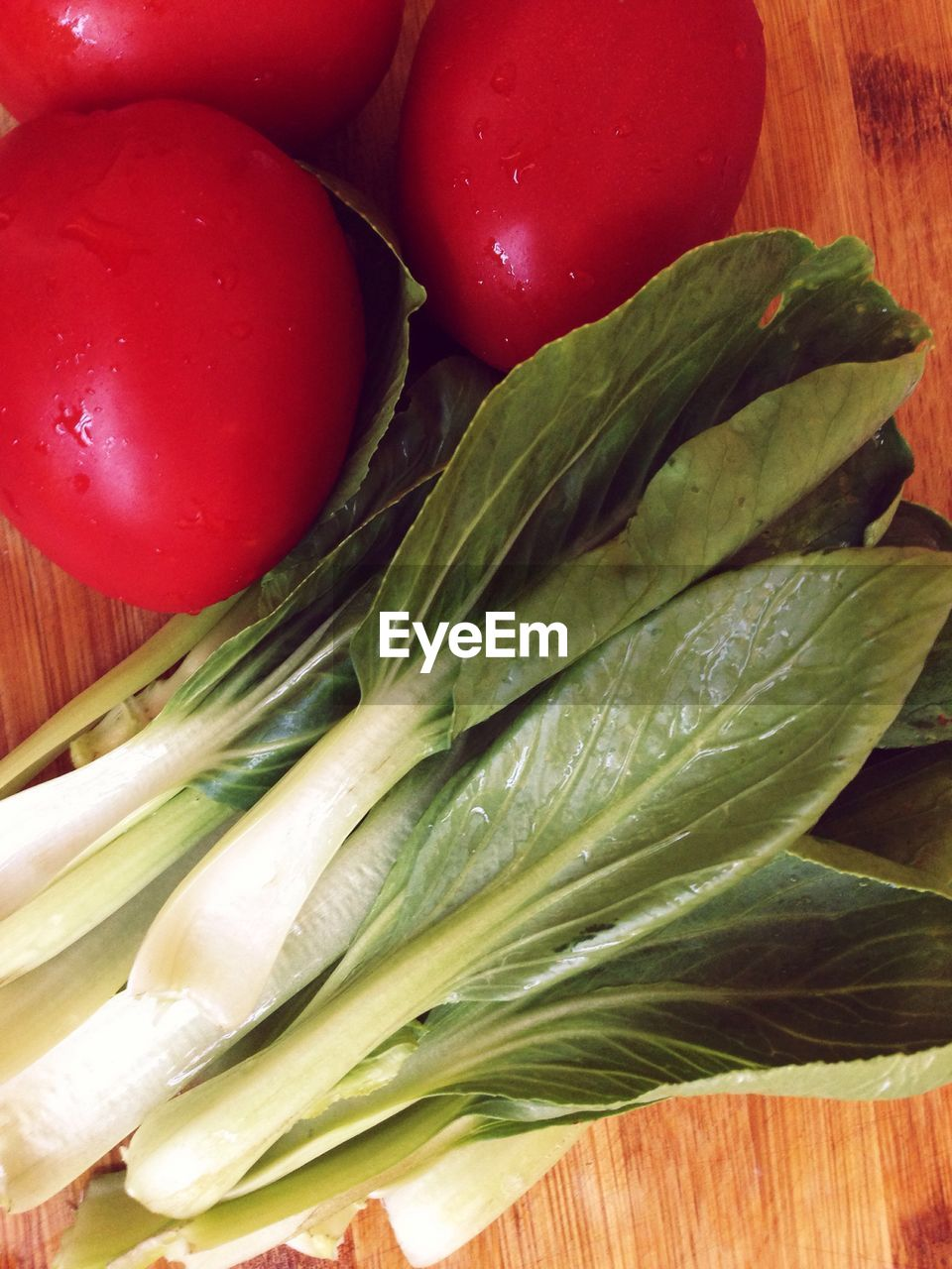 Directly Above Shot Of Chinese Cabbage And Tomatoes On Table