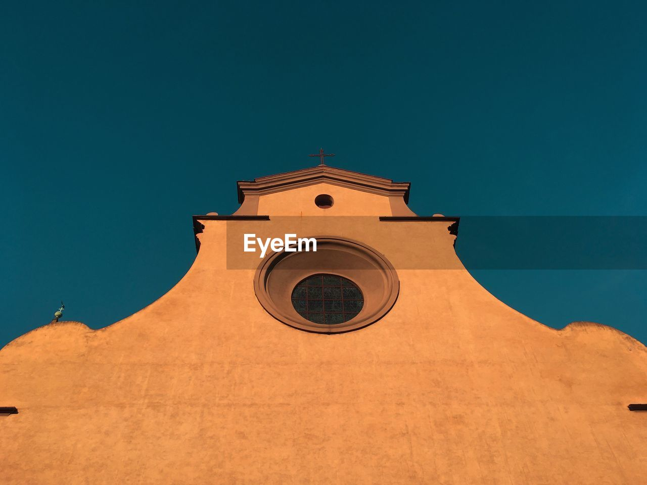 low angle view, architecture, sky, built structure, building exterior, building, no people, blue, clear sky, nature, religion, spirituality, place of worship, belief, copy space, day, tower, sunlight, clock