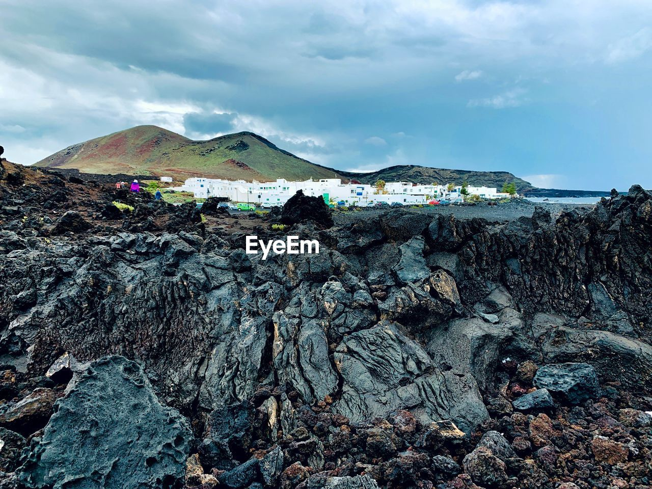 sky, rock, cloud - sky, rock - object, solid, environment, mountain, nature, beauty in nature, day, land, water, scenics - nature, rock formation, landscape, non-urban scene, beach, geology, tranquil scene, no people, outdoors, pollution