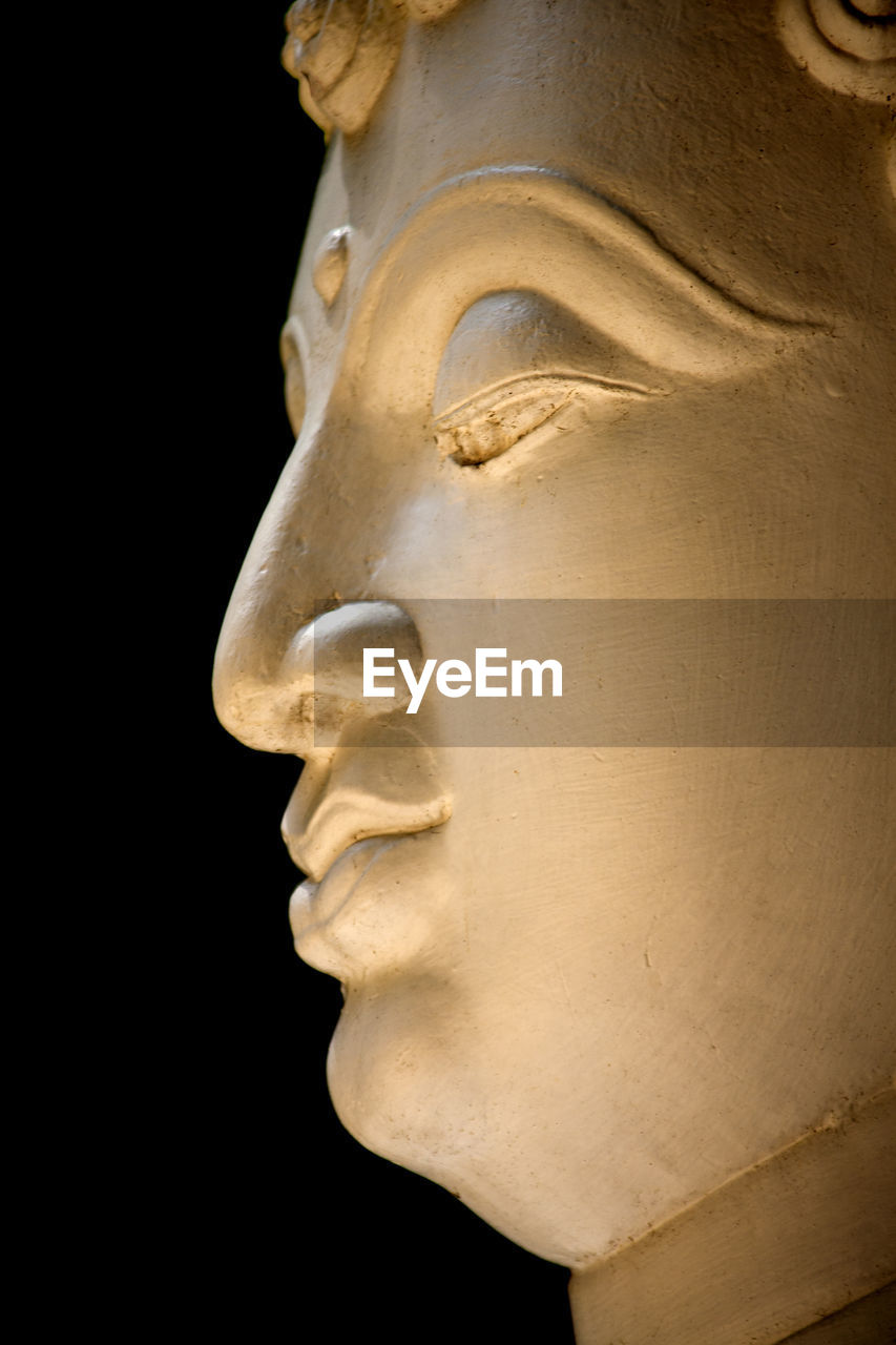 sculpture, art and craft, statue, craft, human representation, representation, history, male likeness, close-up, architecture, low angle view, the past, no people, creativity, religion, spirituality, ancient, belief, black background, fine art statue, profile view, ancient civilization