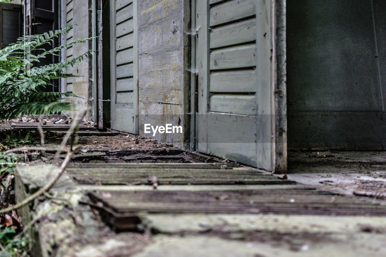 door, abandoned, architecture, no people, building exterior, damaged, built structure, day, doorway, outdoors