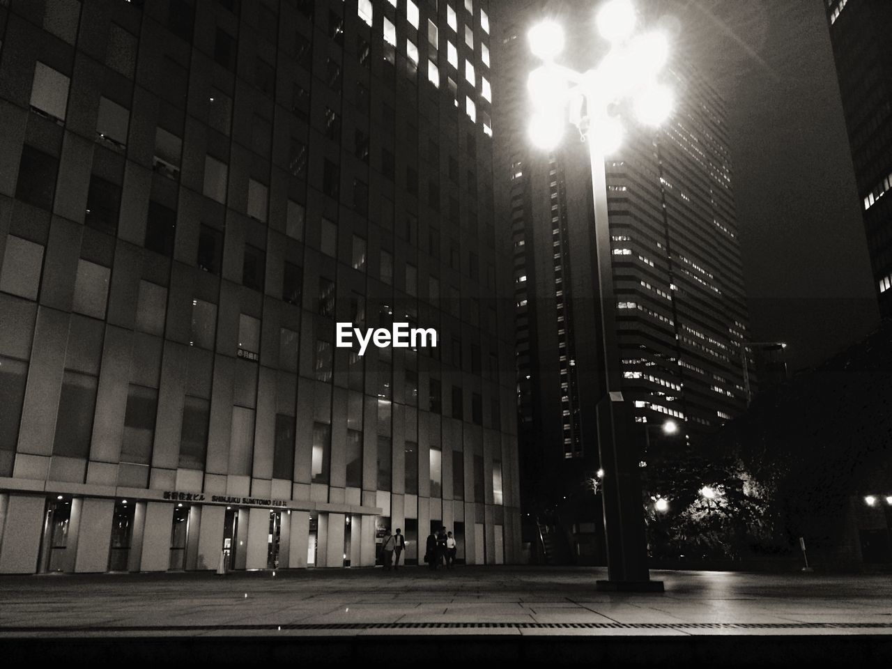 Low angle view of office buildings at night