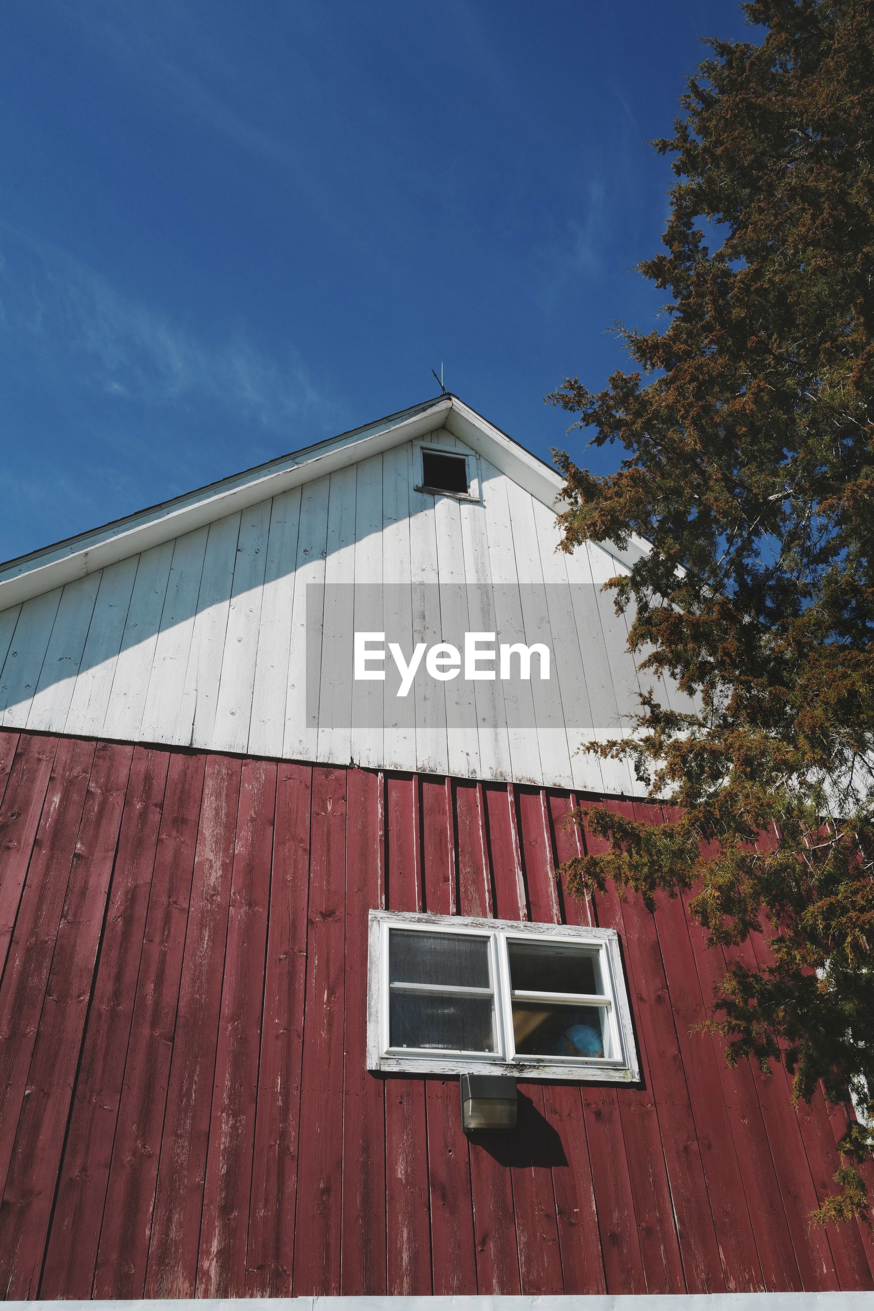 Low angle view of vintage barn against sky