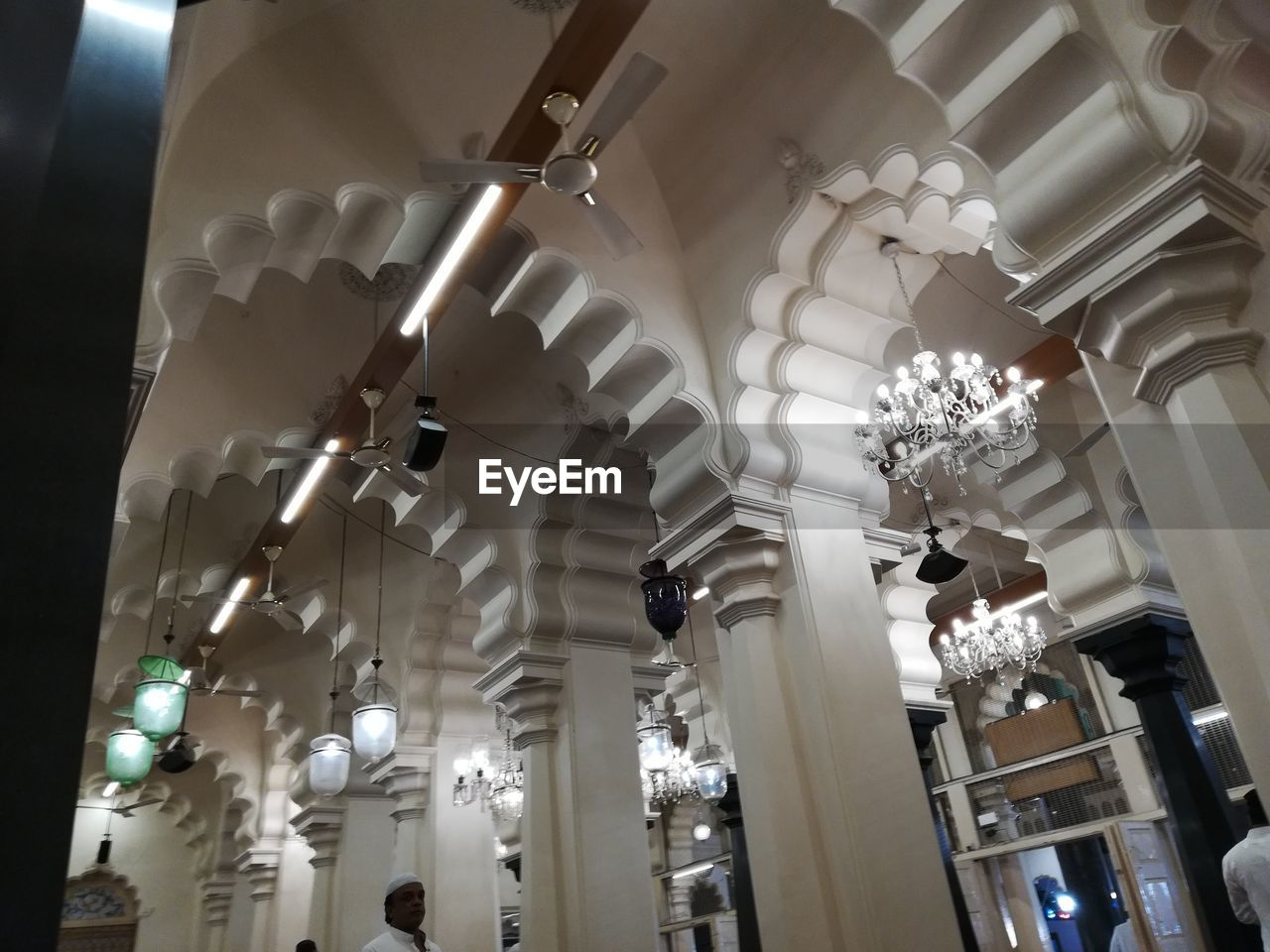 low angle view, ceiling, lighting equipment, indoors, illuminated, architecture, decoration, hanging, building, no people, built structure, chandelier, architectural column, light, white color, white, in a row, pendant light, day, light fixture