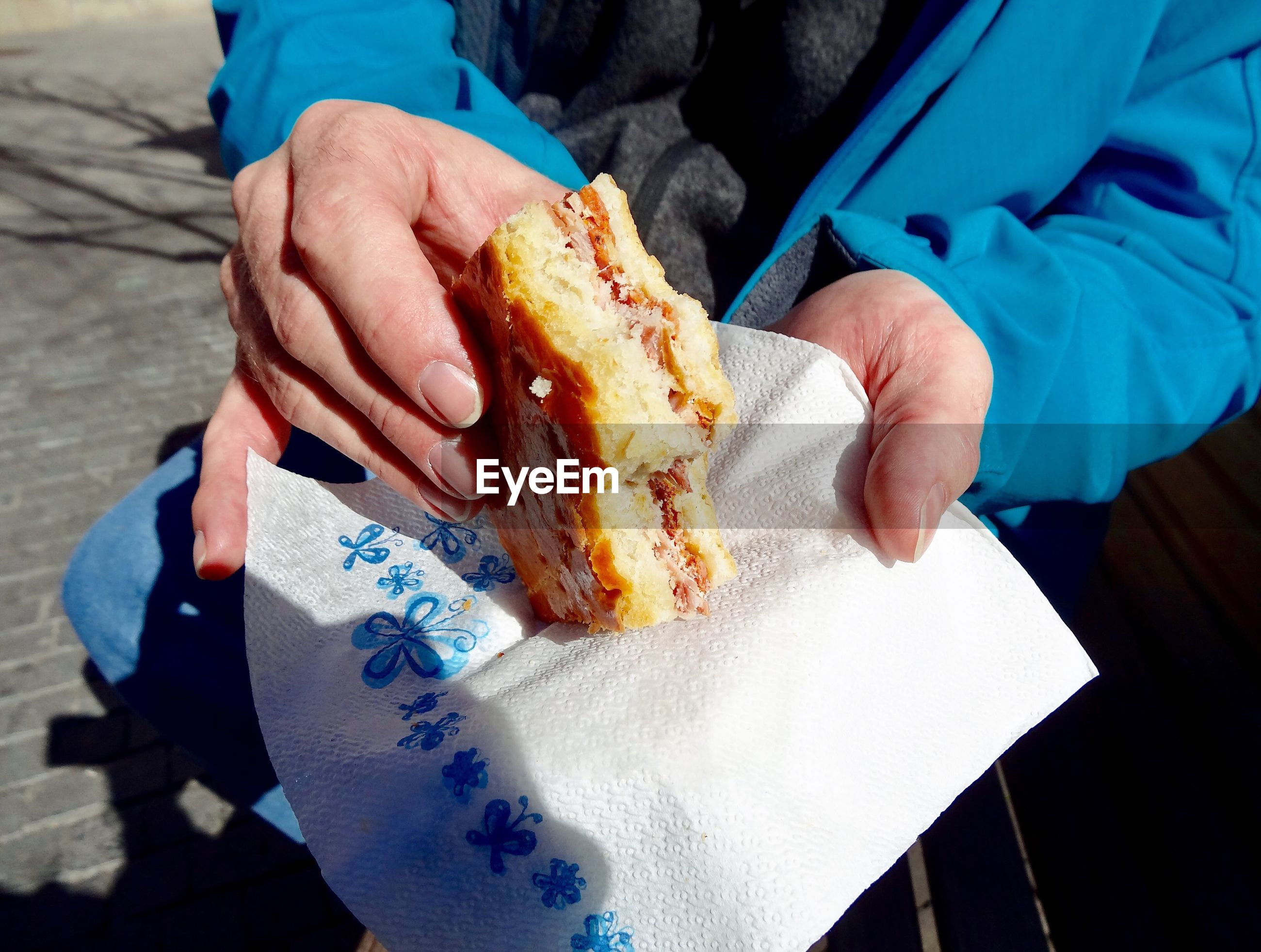 Hands holding street food