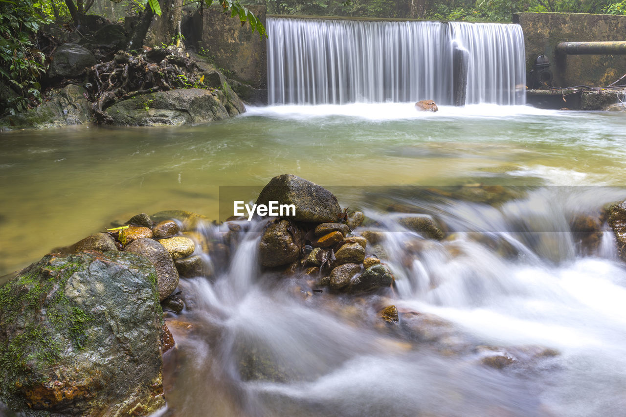 water, motion, waterfall, long exposure, flowing water, blurred motion, rock - object, nature, beauty in nature, no people, river, running water, scenics, outdoors, day, travel destinations, forest, hot spring