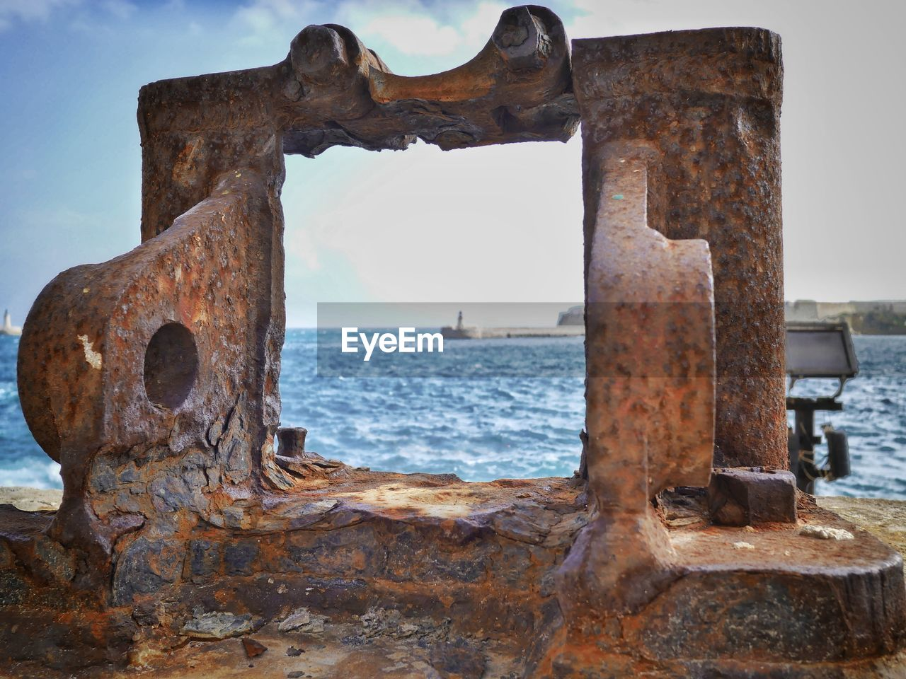 Close-Up Of Rusty Pipe On Beach Against Sky