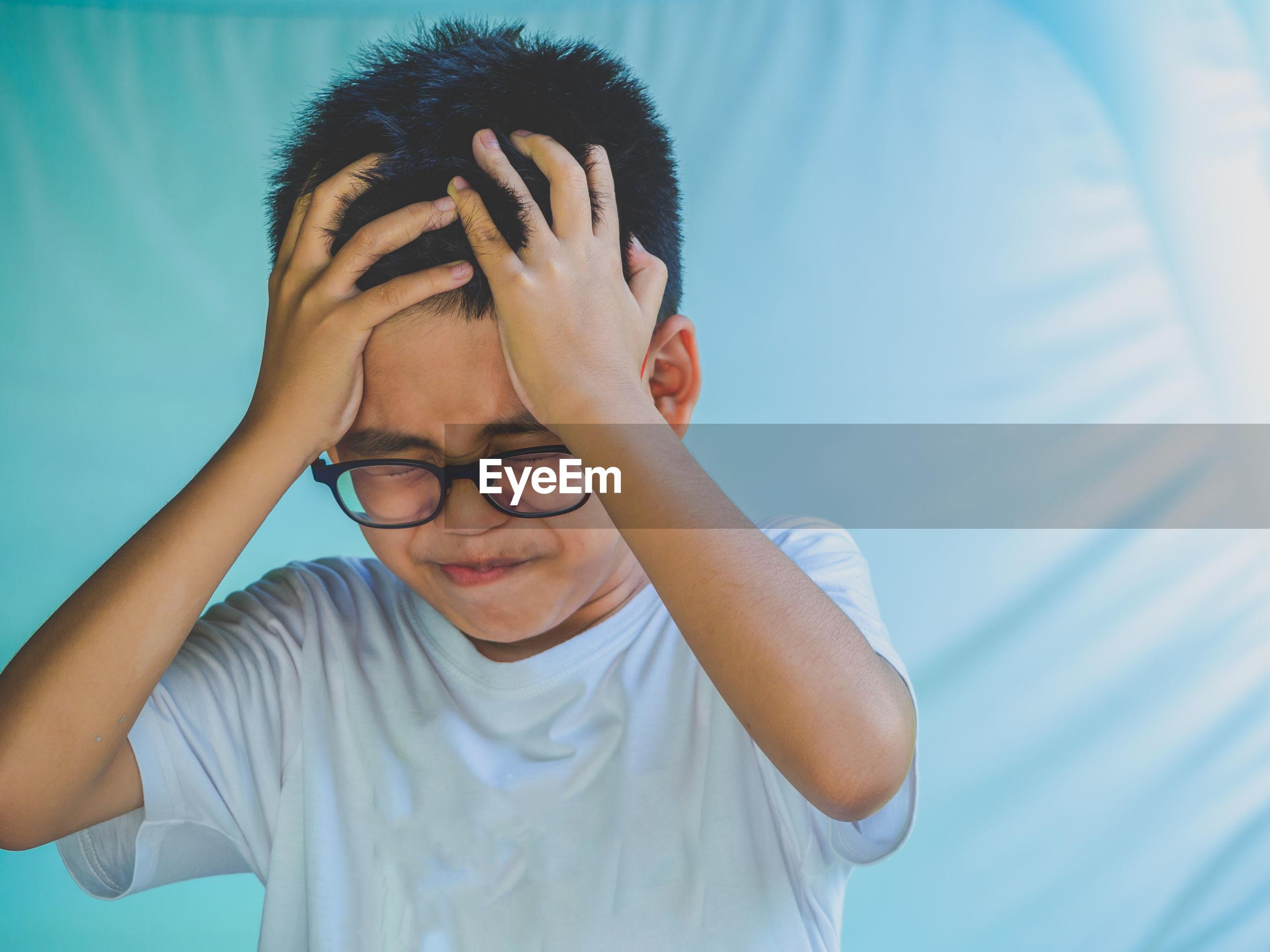 Close-up of worried boy