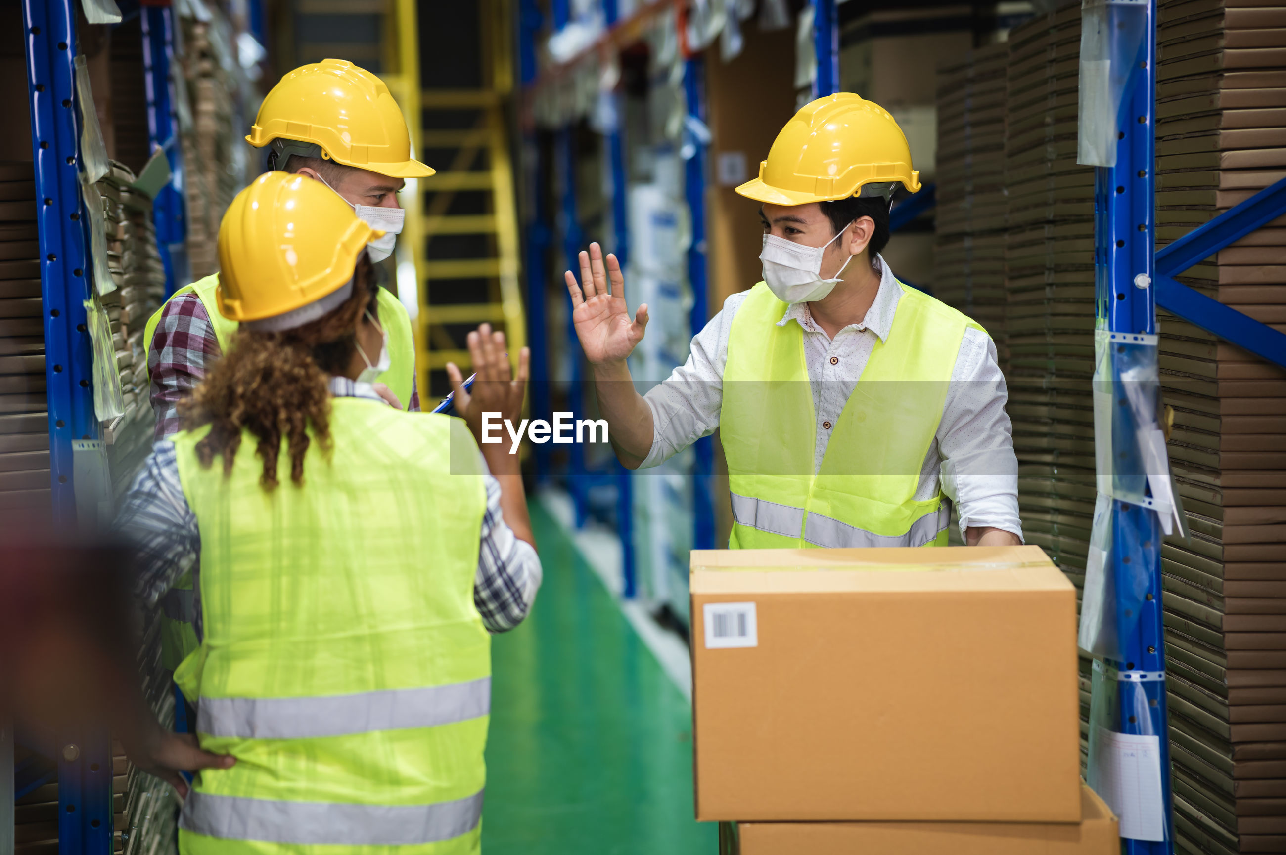 People working with box