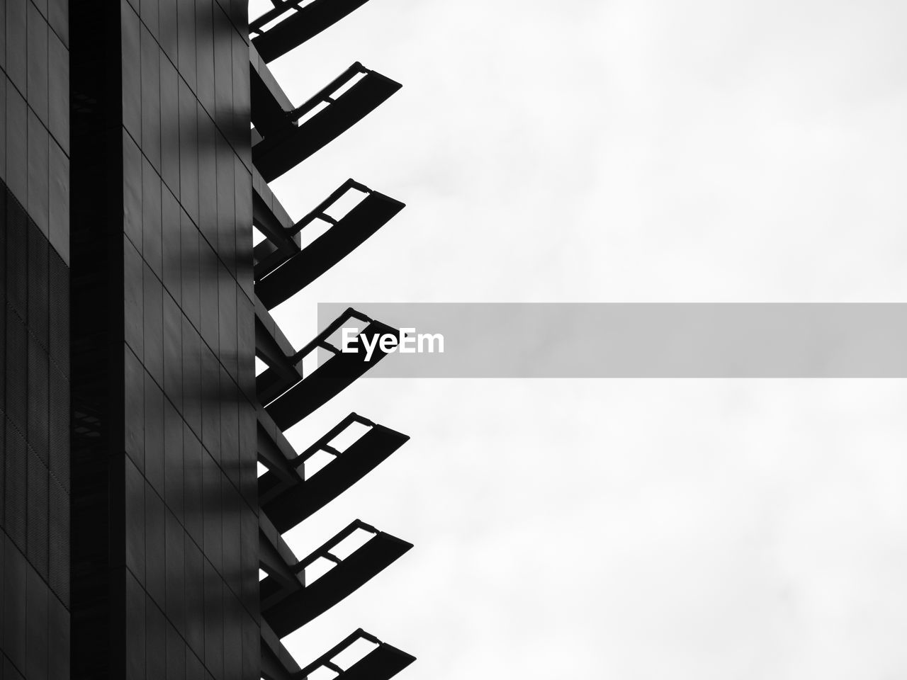 architecture, built structure, sky, low angle view, building, building exterior, no people, day, nature, copy space, outdoors, staircase, communication, steps and staircases, clear sky, pattern, text, wall - building feature, modern, sign, skyscraper