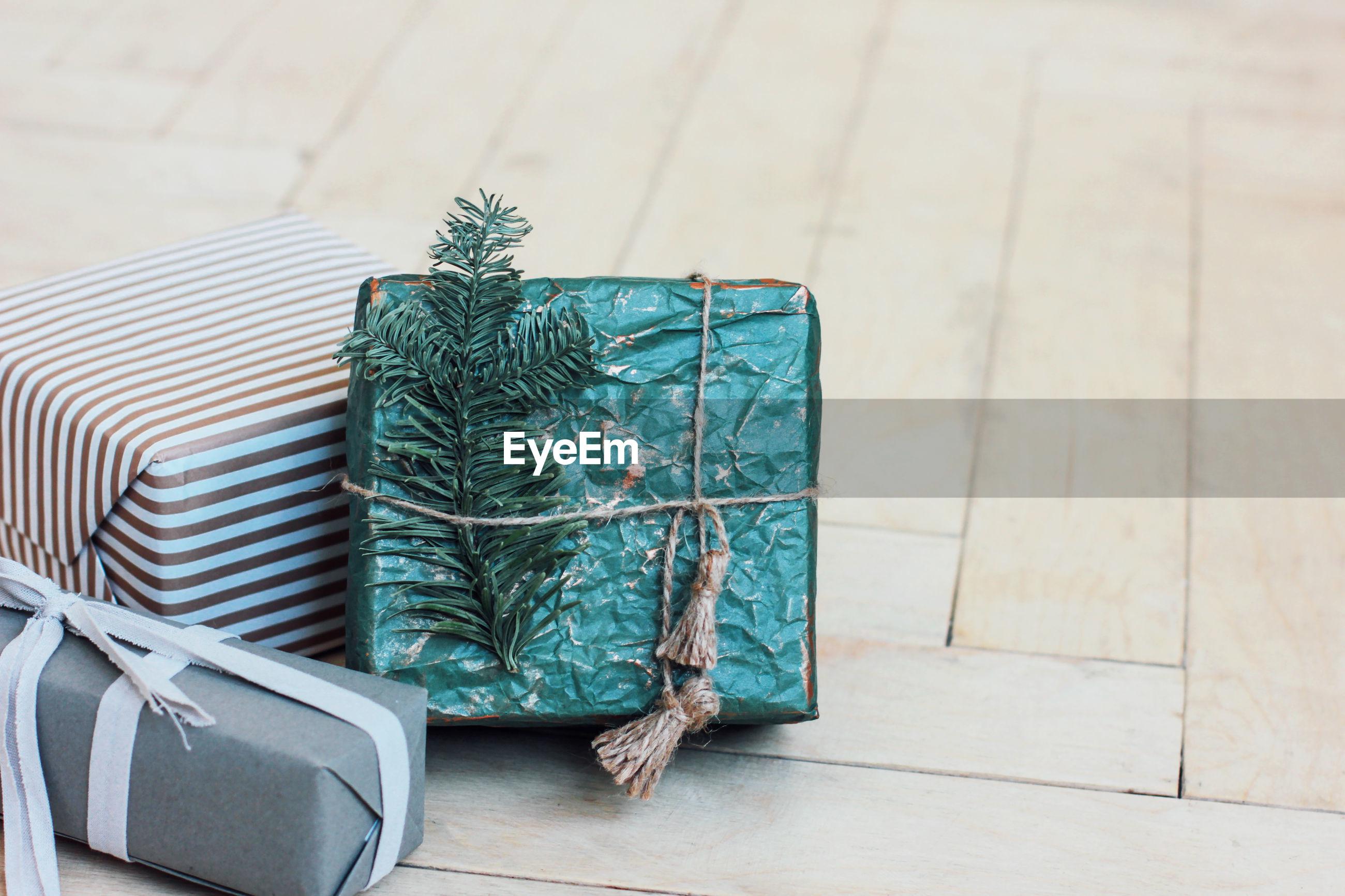 High angle view of christmas gifts on hardwood floor