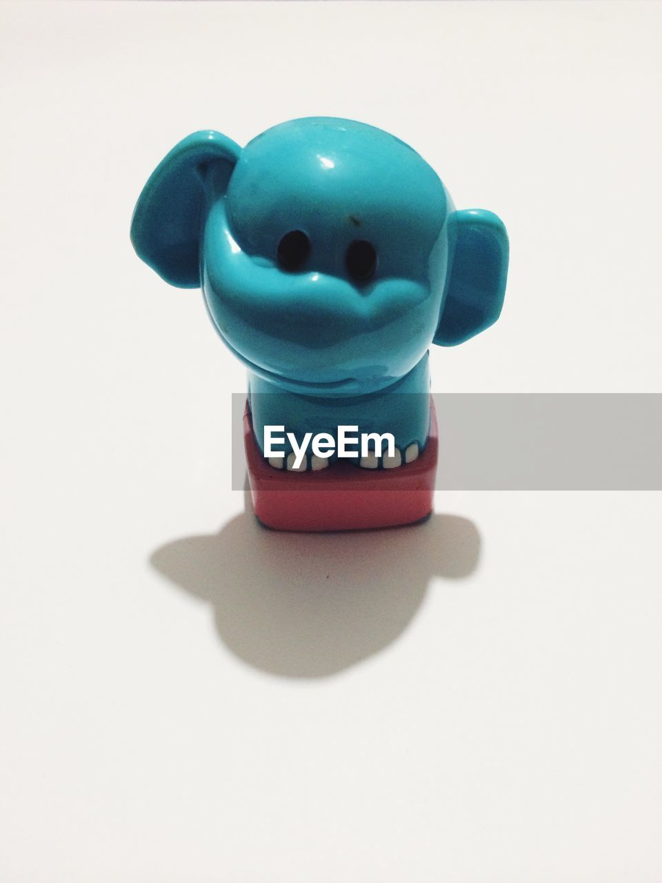 Close-up of toy elephant on white background