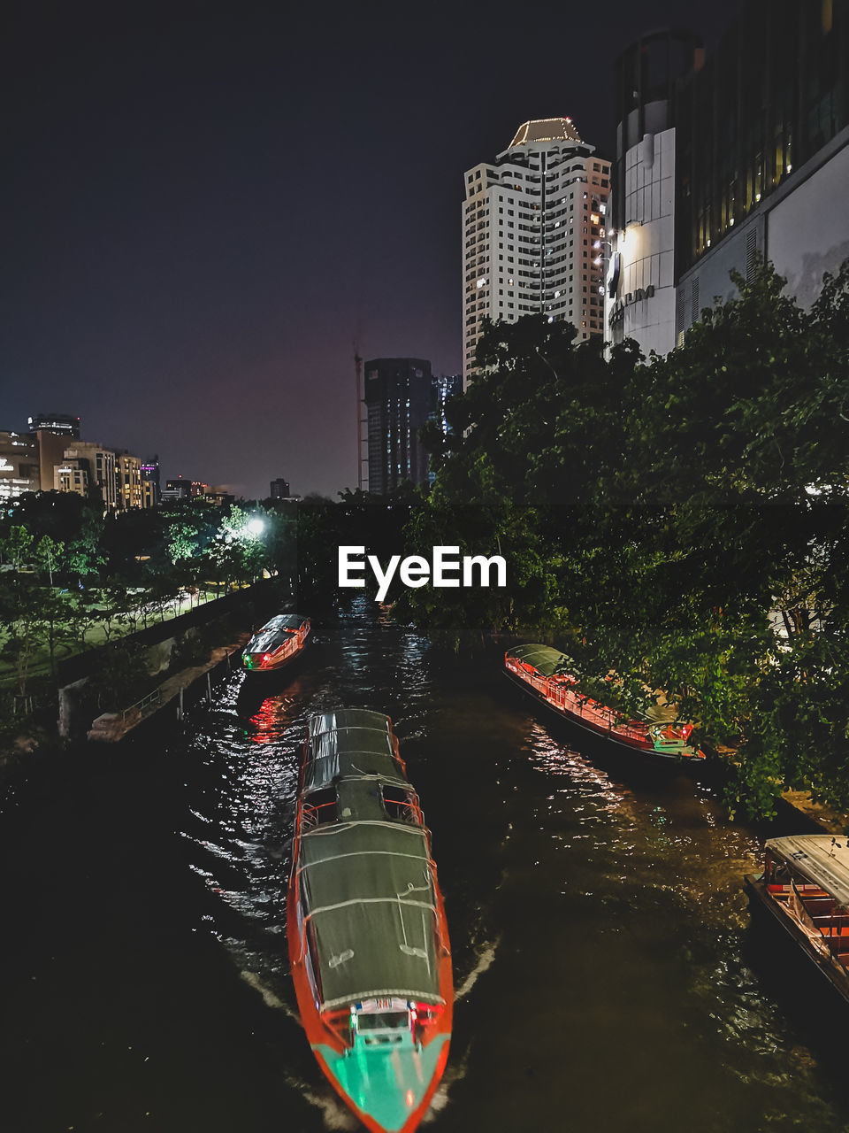building exterior, water, built structure, architecture, city, building, transportation, nature, nautical vessel, tree, mode of transportation, plant, sky, canal, illuminated, night, waterfront, no people, outdoors, office building exterior, cityscape, skyscraper