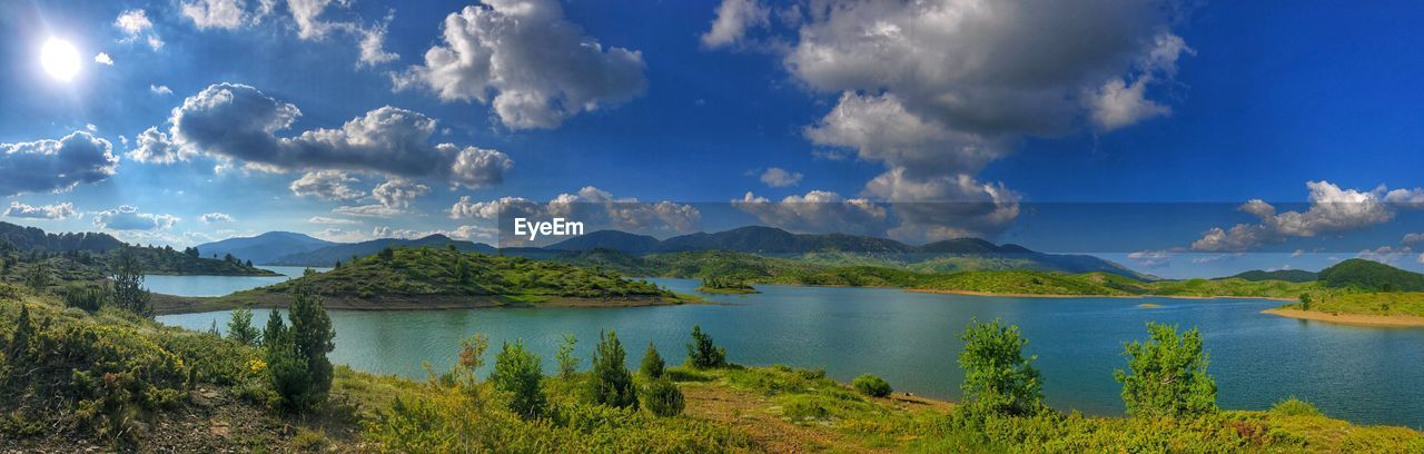 sky, cloud - sky, scenics - nature, water, tranquil scene, tranquility, mountain, beauty in nature, lake, non-urban scene, nature, plant, no people, mountain range, day, tree, environment, landscape, idyllic, outdoors