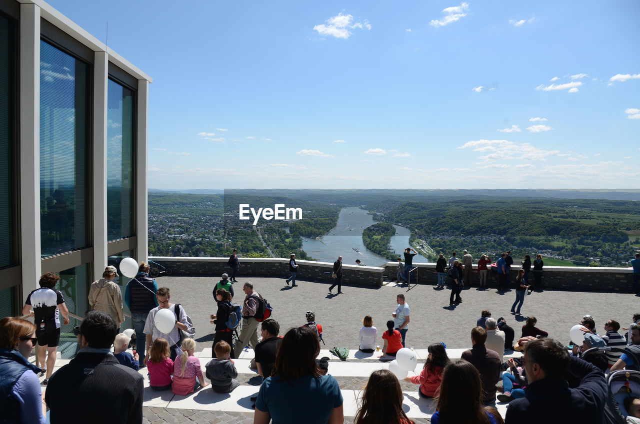 GROUP OF PEOPLE LOOKING AT VIEW