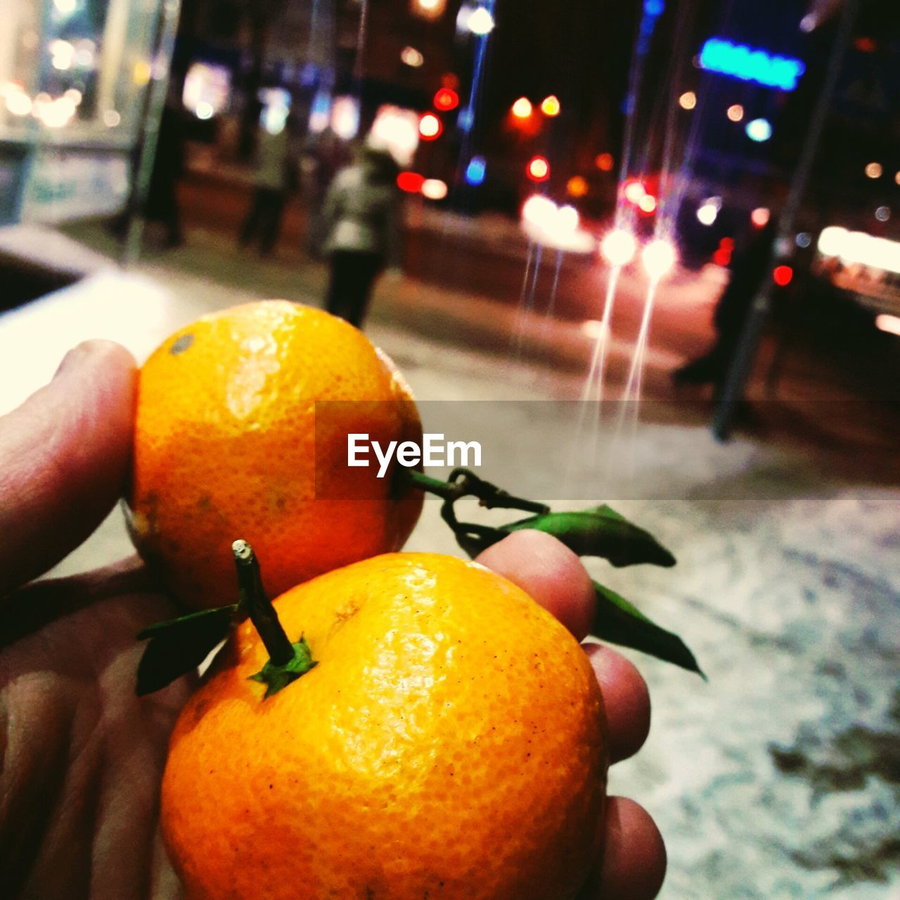 fruit, food and drink, healthy eating, orange - fruit, citrus fruit, food, human hand, freshness, focus on foreground, orange color, close-up, human body part, outdoors, healthy lifestyle, one person, day, people