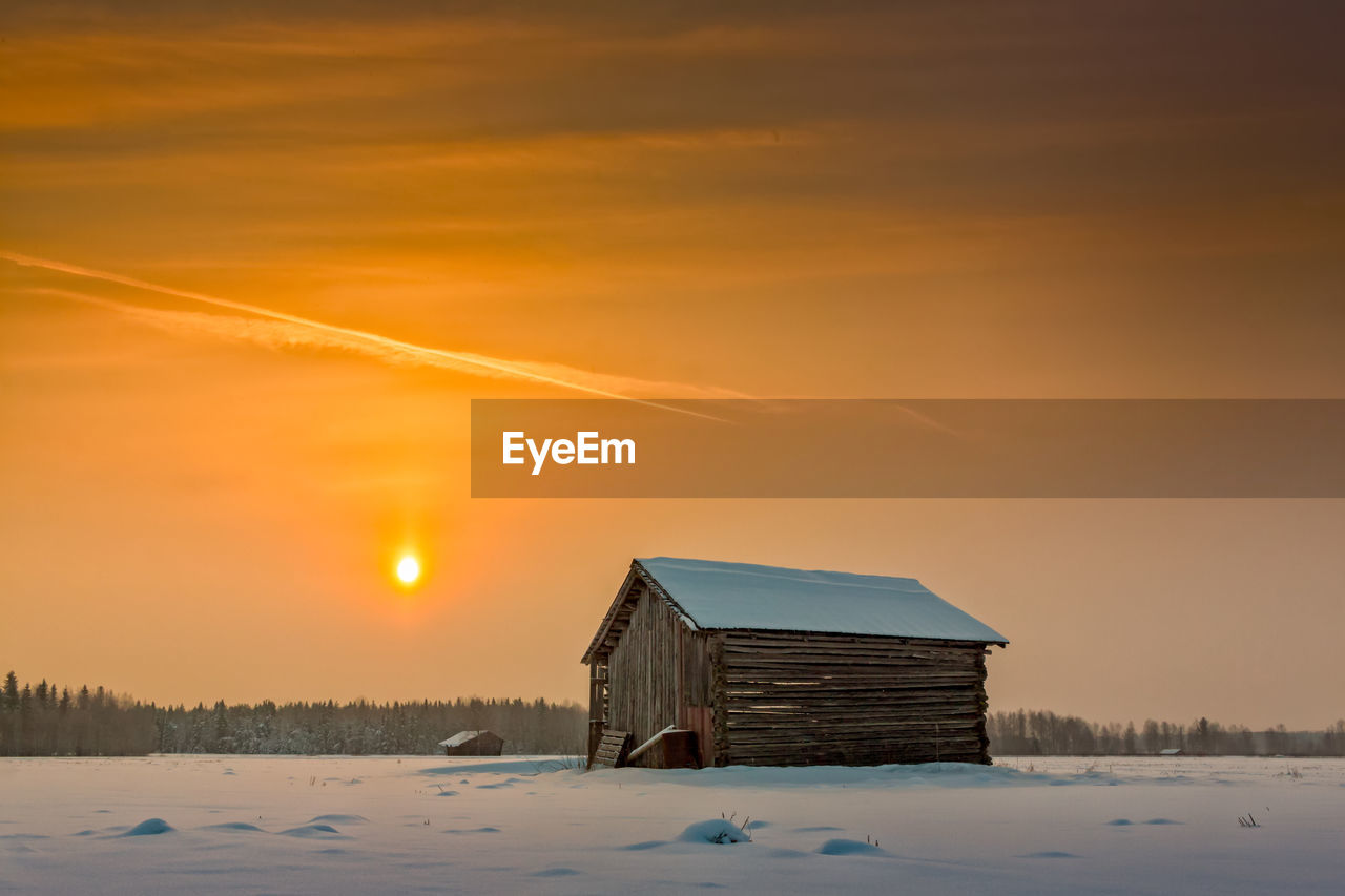 sunset, winter, cold temperature, snow, orange color, built structure, nature, scenics, house, beauty in nature, architecture, sky, no people, building exterior, tranquility, outdoors, tranquil scene