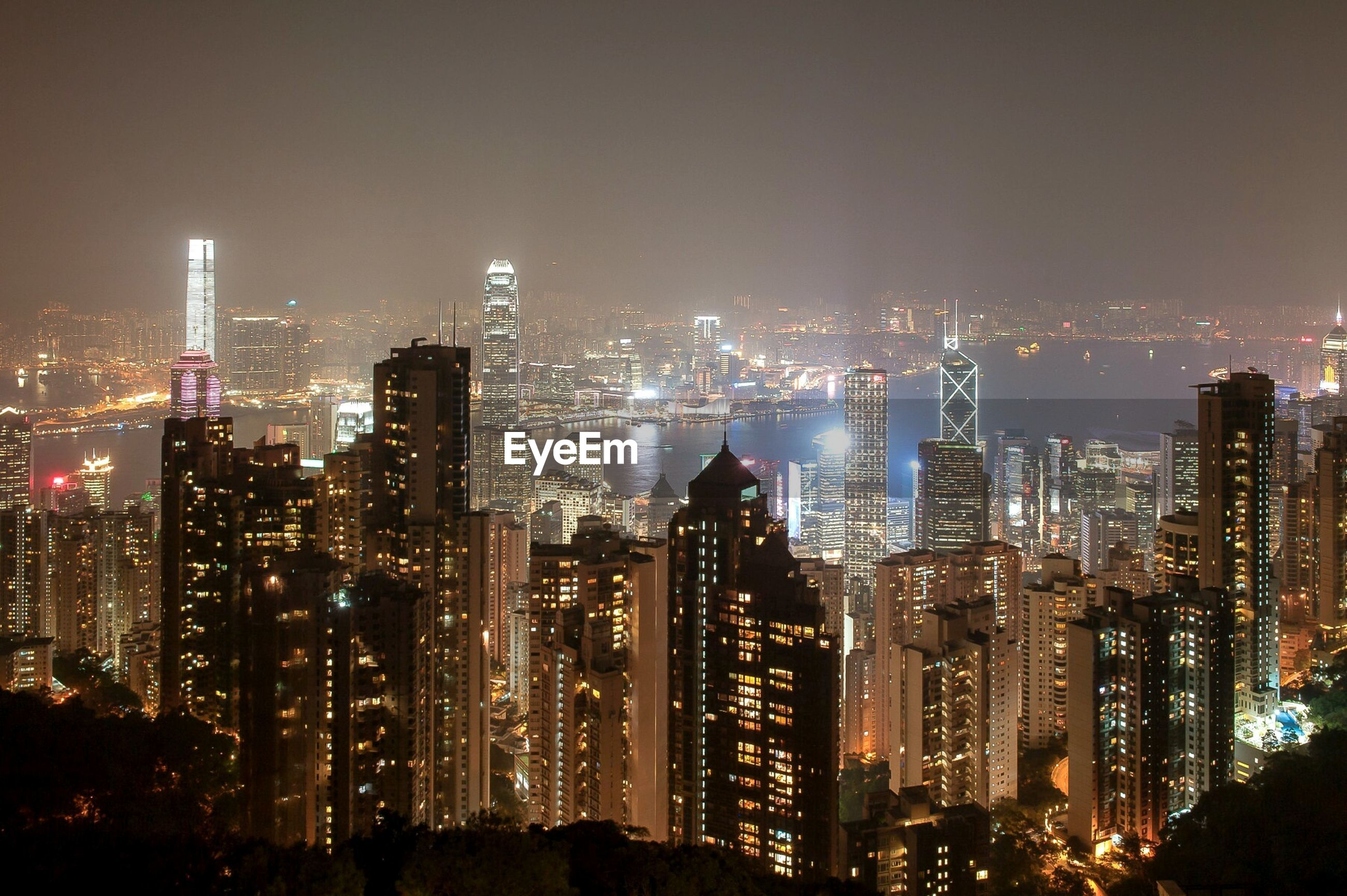 city, illuminated, night, cityscape, skyscraper, building exterior, architecture, built structure, tall - high, urban skyline, tower, modern, crowded, office building, financial district, clear sky, city life, tall, capital cities, high angle view