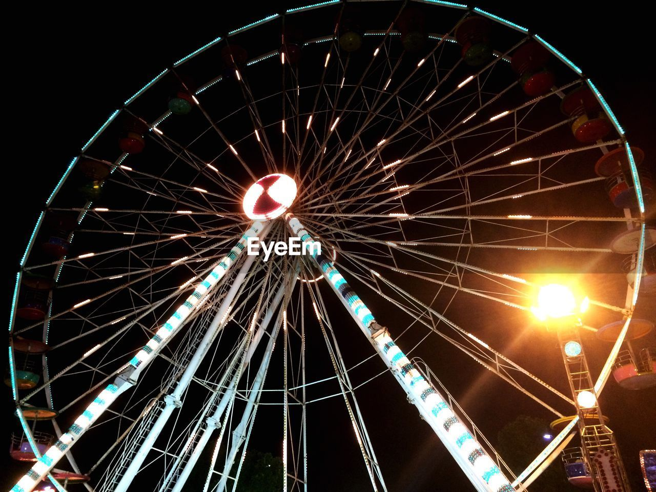 amusement park, arts culture and entertainment, ferris wheel, amusement park ride, night, low angle view, illuminated, big wheel, no people, outdoors, clear sky, sky