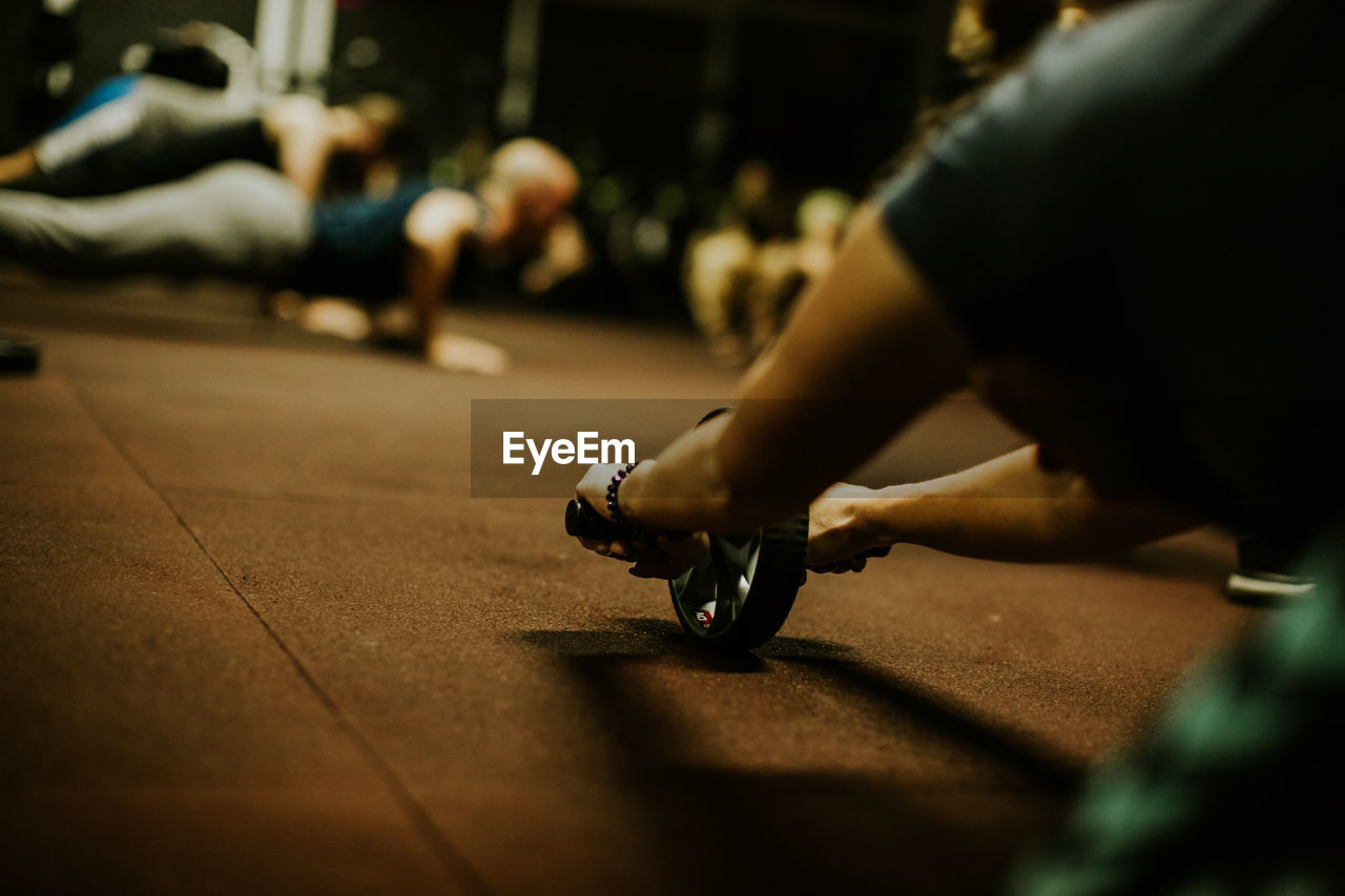 Defocused image of woman exercising at gym