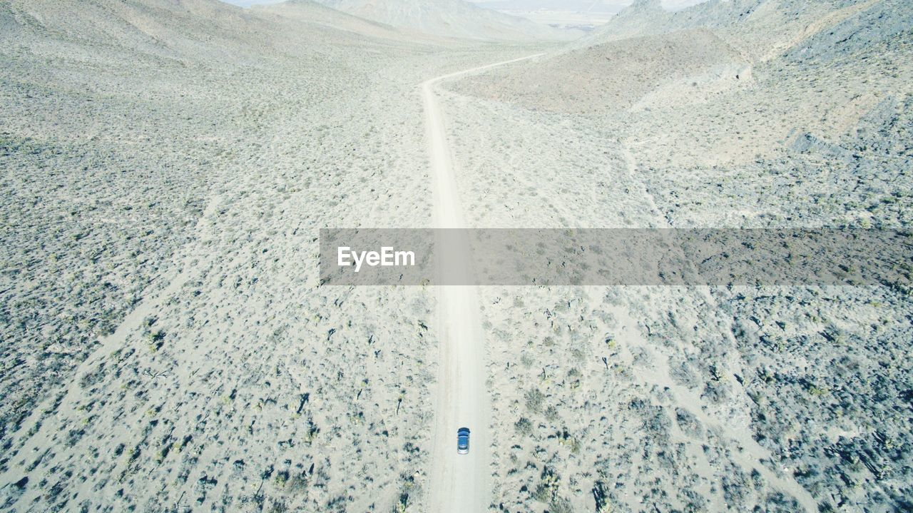 Aerial View Of Car Moving On Road At Red Rock Canyon National Conservation Area