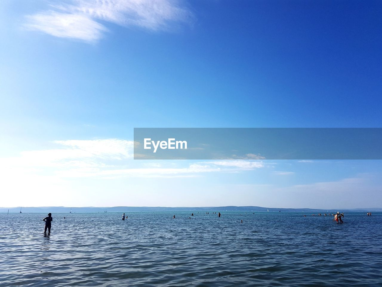 water, sea, sky, beauty in nature, horizon over water, real people, horizon, scenics - nature, waterfront, day, blue, leisure activity, tranquility, lifestyles, nature, tranquil scene, vacations, cloud - sky, trip, outdoors