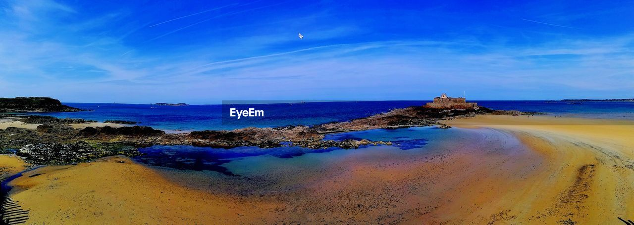 sea, beauty in nature, tranquility, water, sky, nature, scenics, tranquil scene, blue, beach, rock - object, no people, outdoors, horizon over water, landscape, day