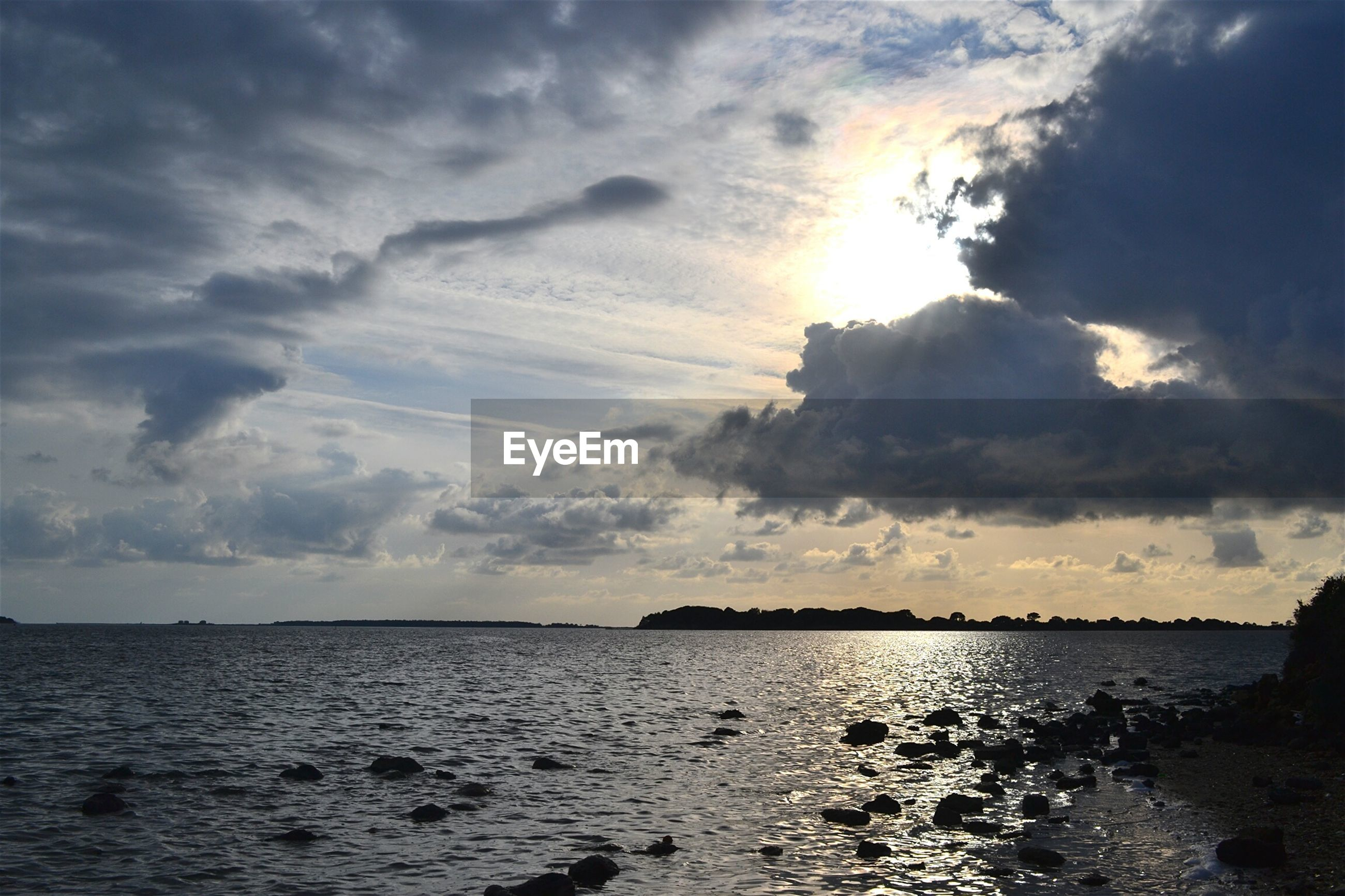 sea, water, sky, horizon over water, scenics, cloud - sky, tranquil scene, beauty in nature, tranquility, sunset, cloudy, nature, cloud, idyllic, beach, waterfront, sun, outdoors, sunlight, shore