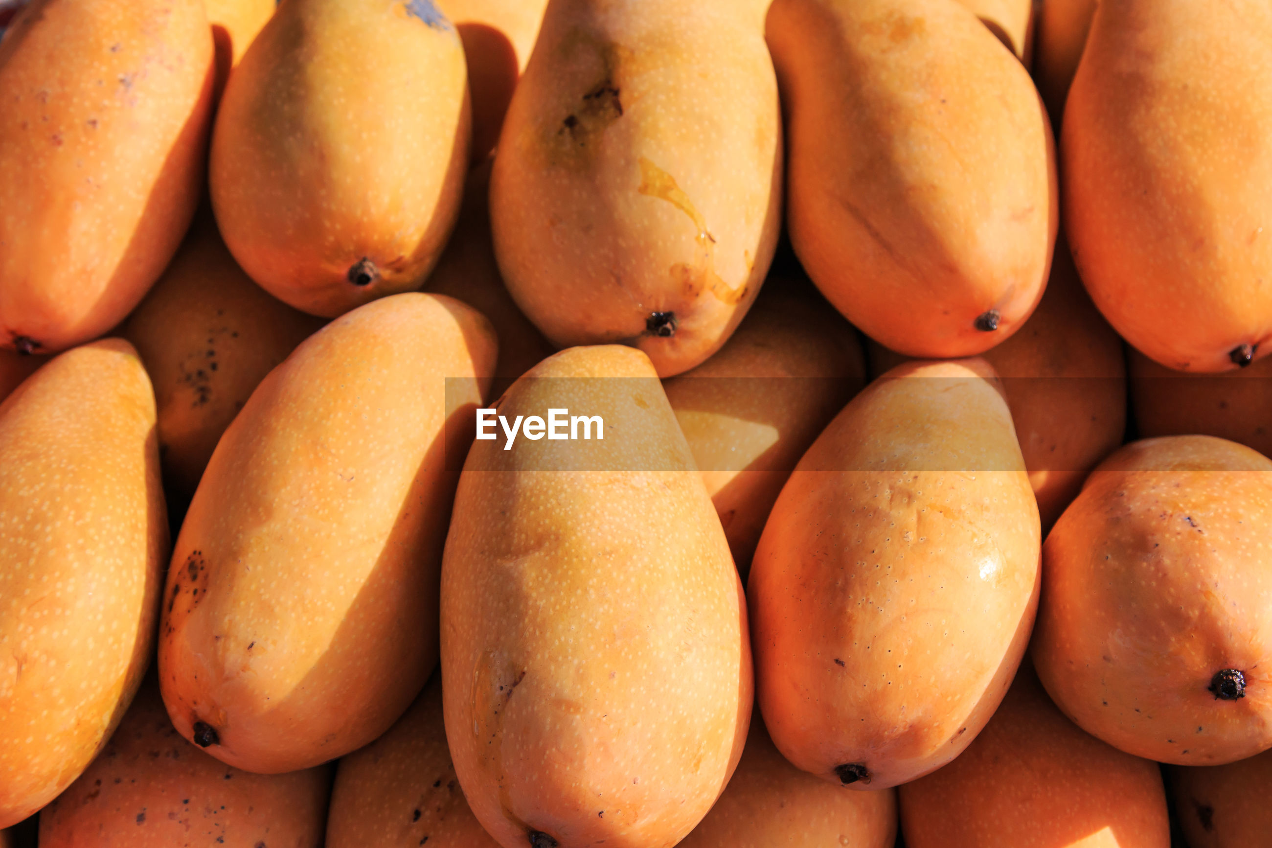 Full frame shot of mangoes for sale at market stall