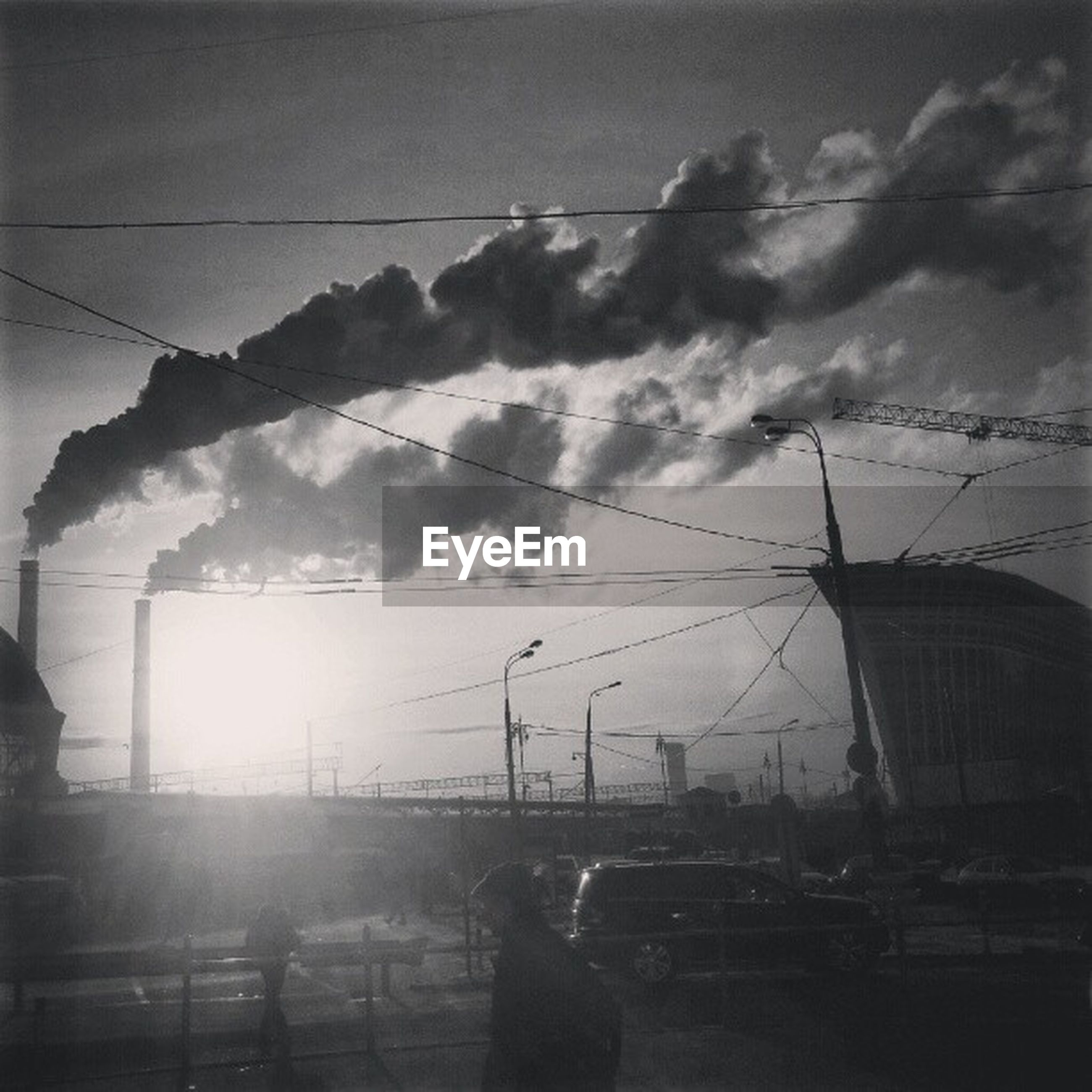 sky, cloud - sky, building exterior, built structure, architecture, cloudy, power line, electricity pylon, fuel and power generation, cloud, sunset, crane - construction machinery, construction site, transportation, power supply, electricity, industry, low angle view, technology, silhouette