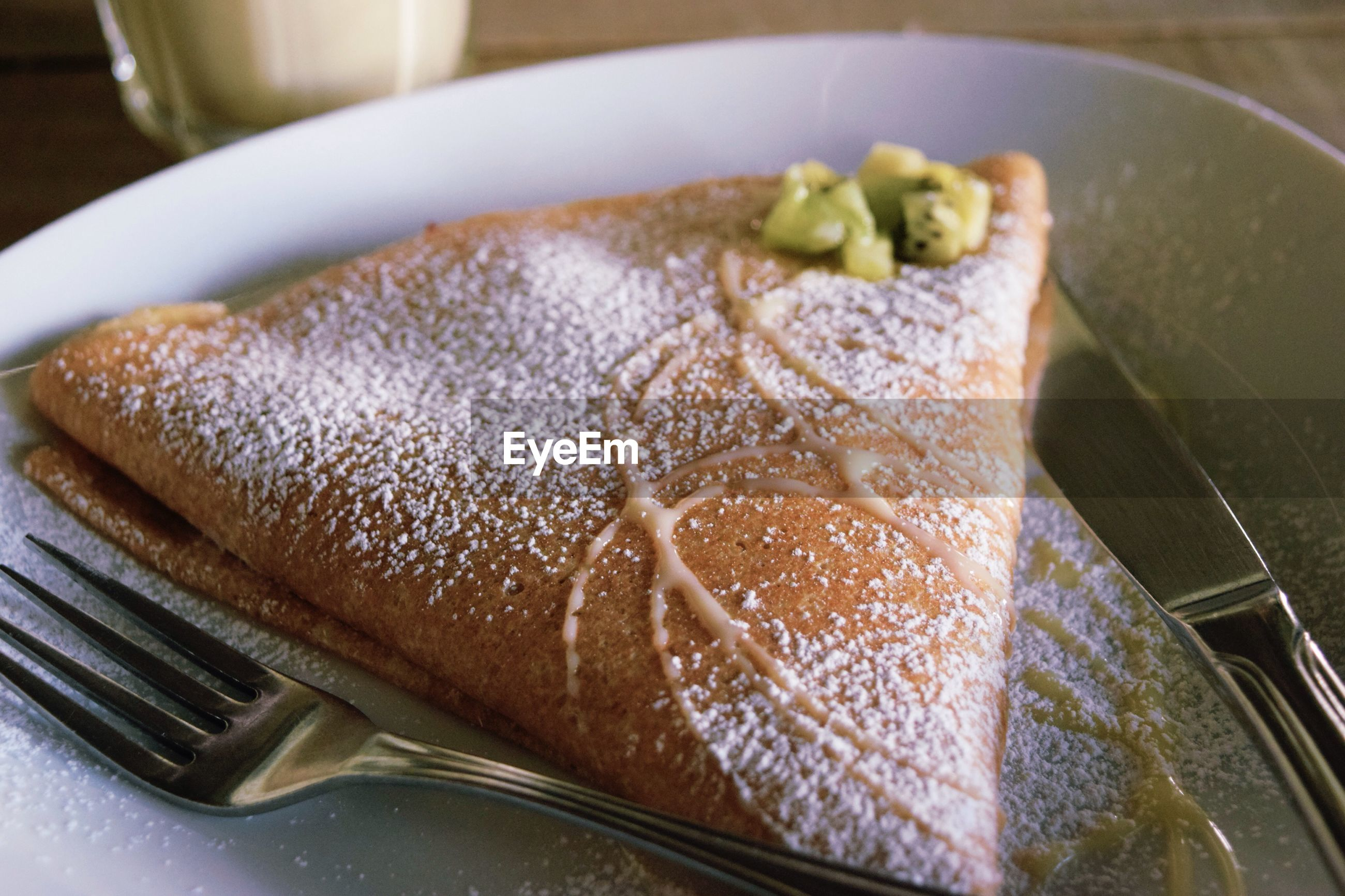Close-up of fresh crepe served in plate on table