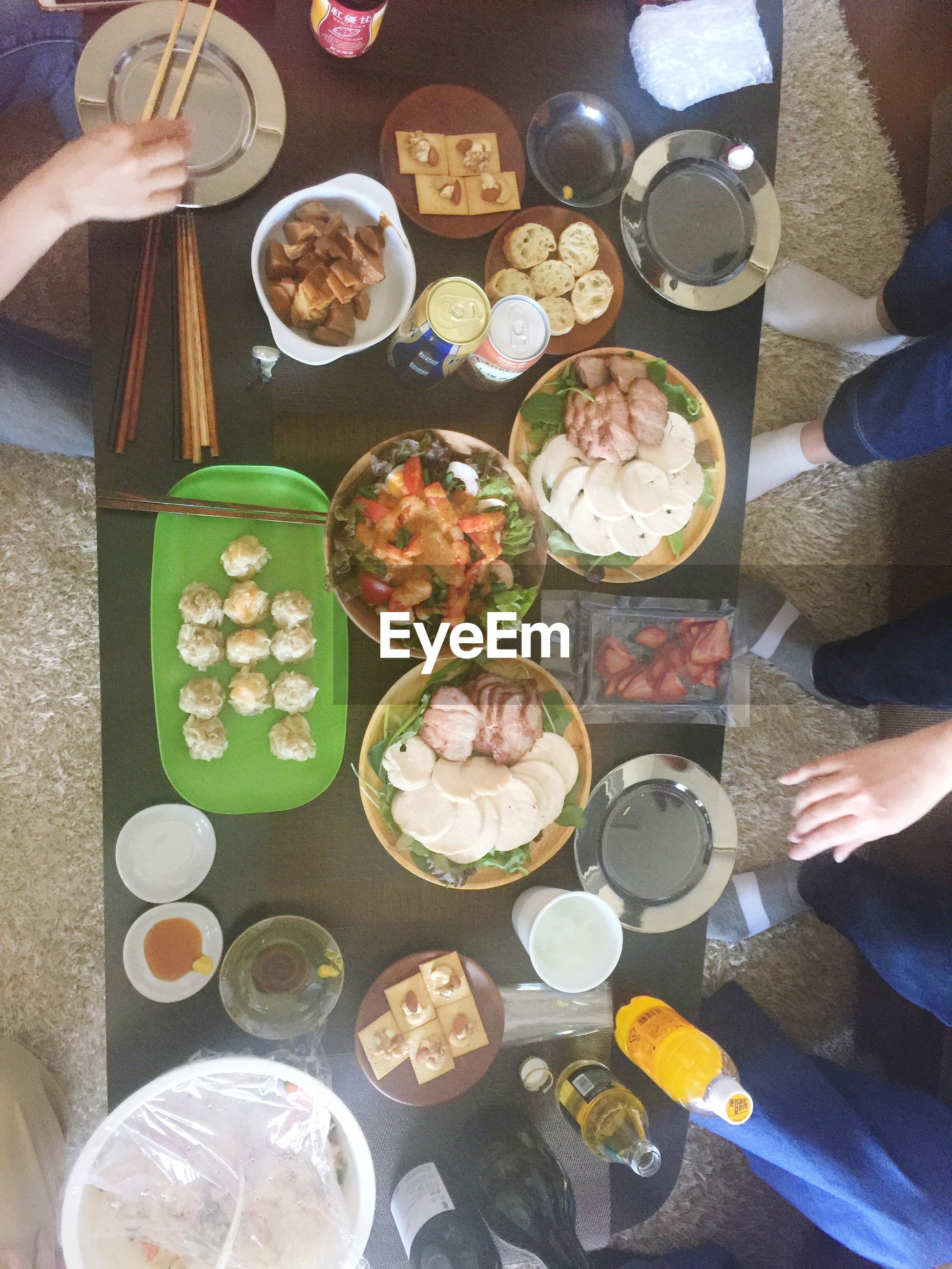 human hand, food and drink, real people, plate, human body part, holding, food, table, freshness, drink, ready-to-eat, men, leisure activity, lifestyles, high angle view, directly above, indoors, serving size, refreshment, bowl, sitting, healthy eating, women, chopsticks, drinking glass, friendship, day, people