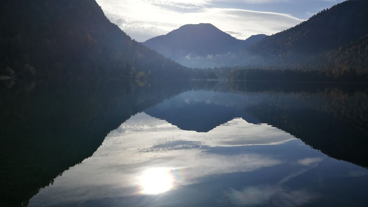 reflection, lake, tranquil scene, mountain, tranquility, water, nature, scenics, beauty in nature, idyllic, no people, mountain range, outdoors, sky, day, cloud - sky, tree