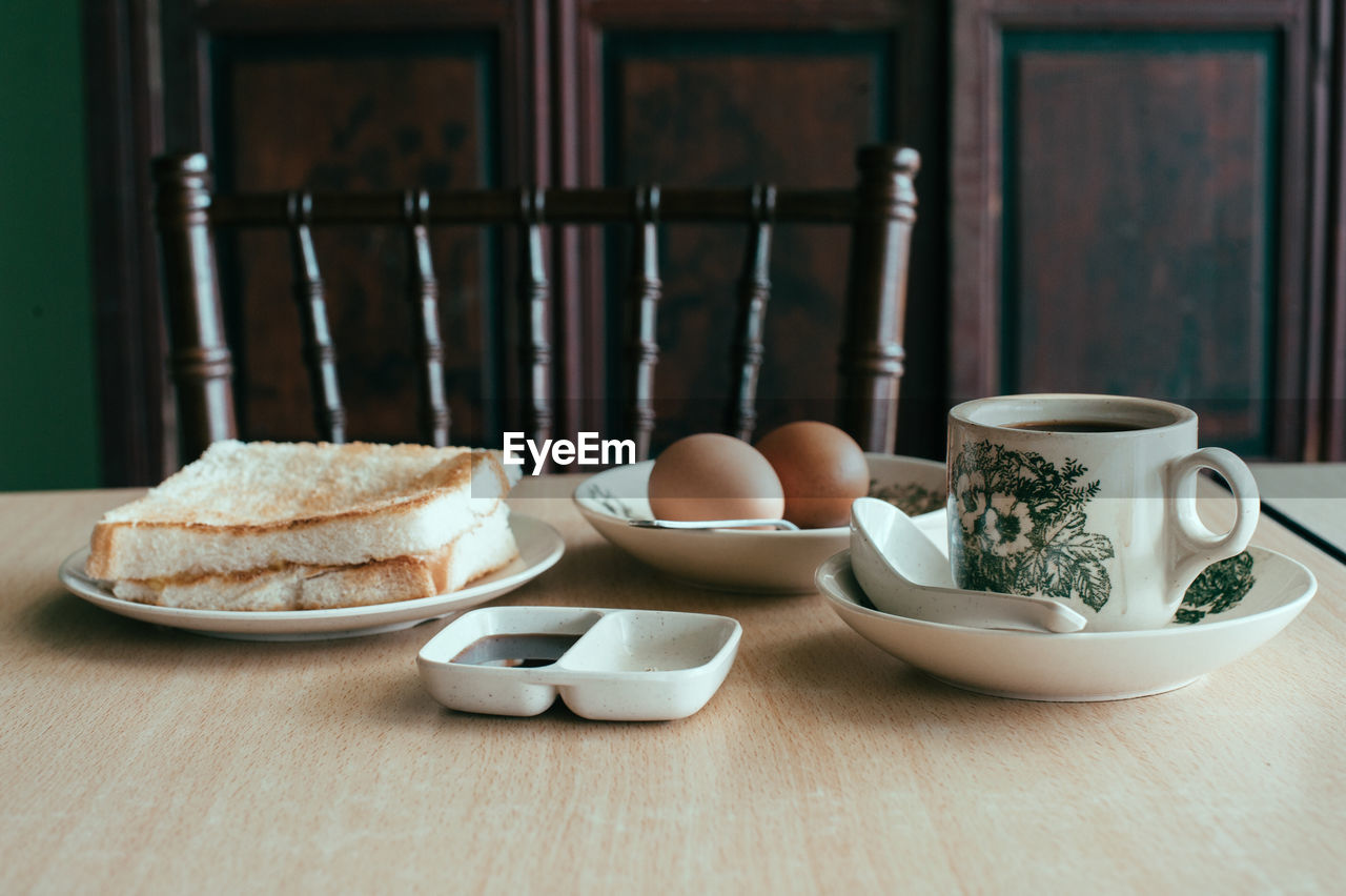 Breakfast served in plates on table at home