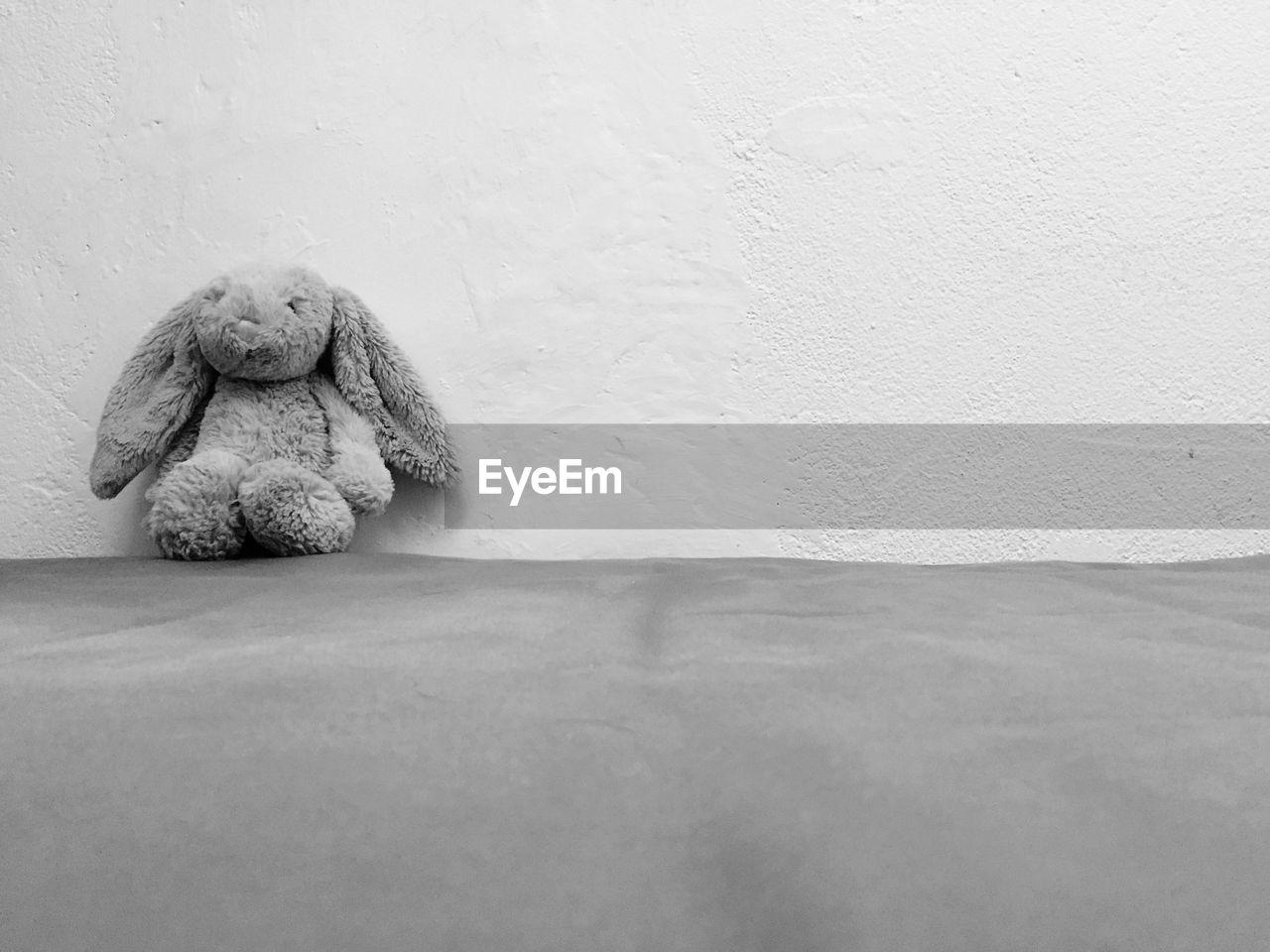 Close-Up Of Stuffed Toy Against The Wall