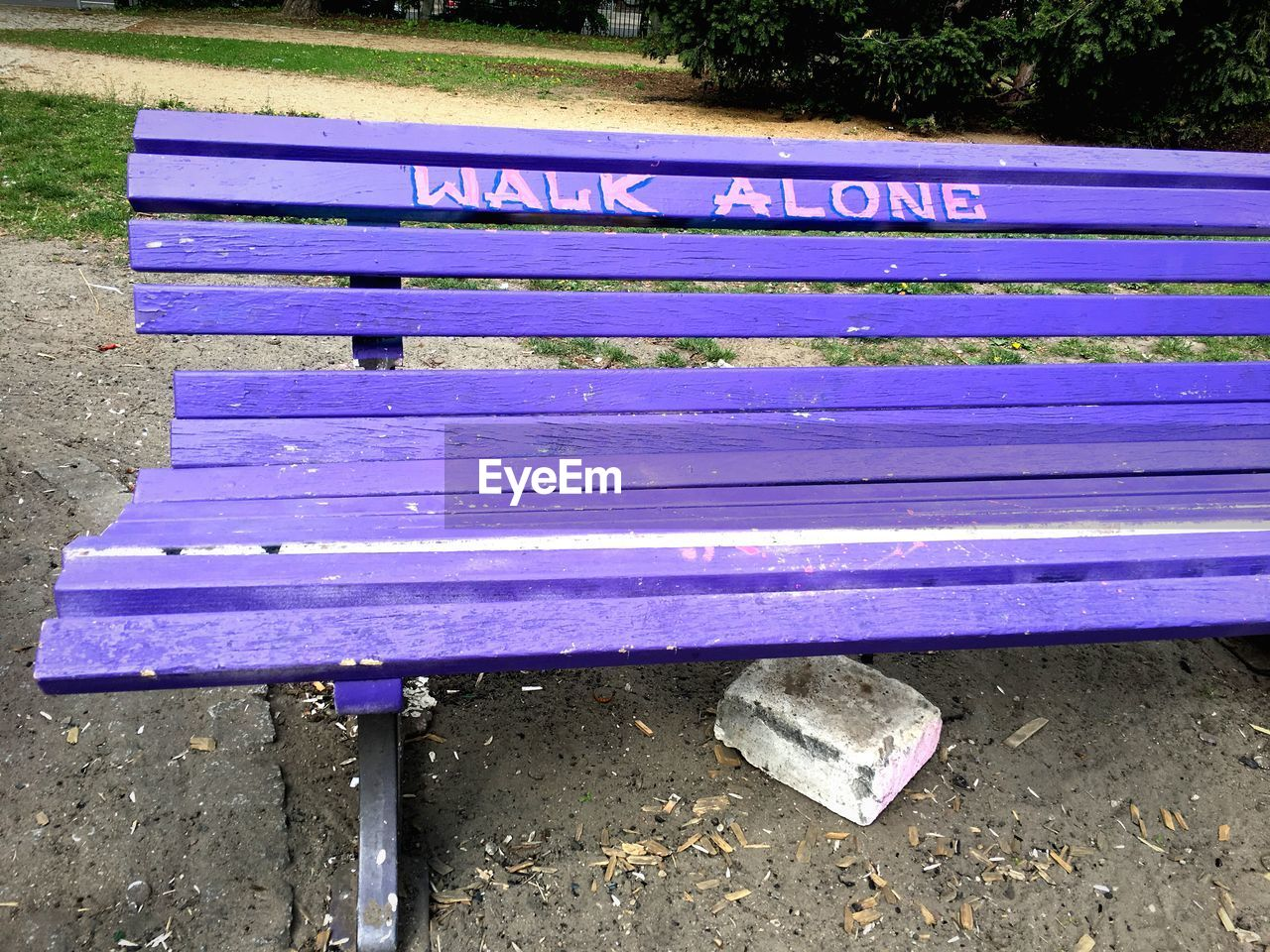 bench, seat, day, western script, park bench, empty, park, text, no people, high angle view, absence, nature, park - man made space, outdoors, communication, blue, relaxation, wood - material, land, purple, message