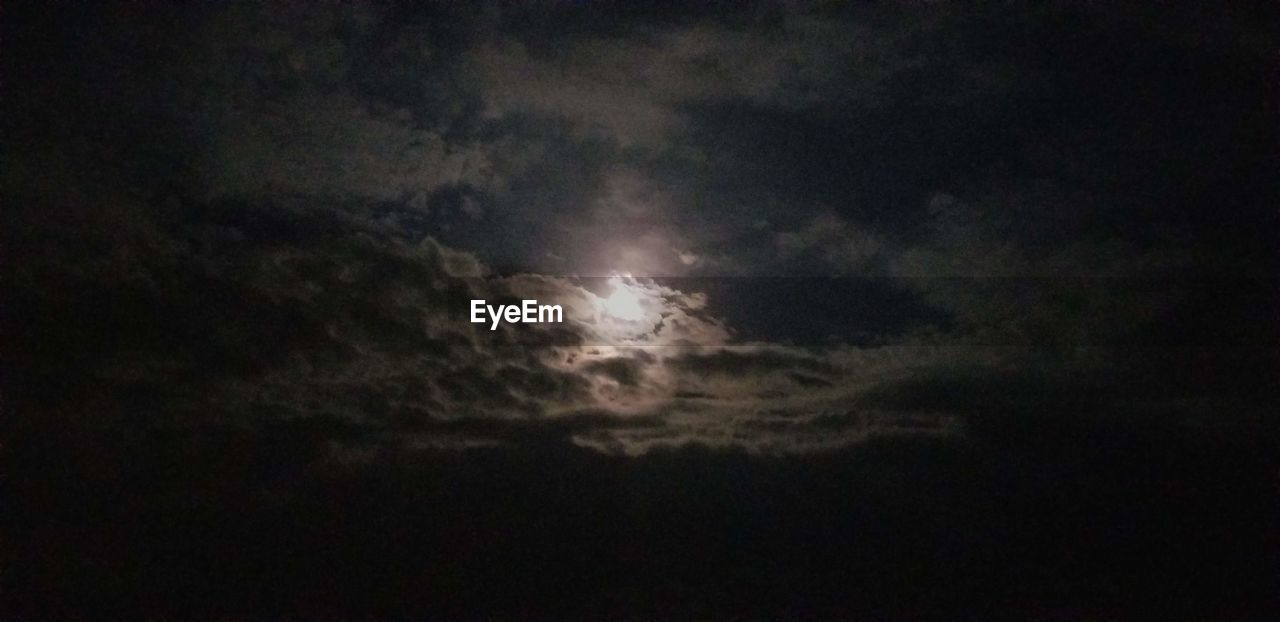 sky, cloud - sky, beauty in nature, scenics - nature, low angle view, night, tranquility, tranquil scene, moon, nature, no people, idyllic, astronomy, overcast, outdoors, space, majestic, dark, cloudscape, moonlight, planetary moon, ominous