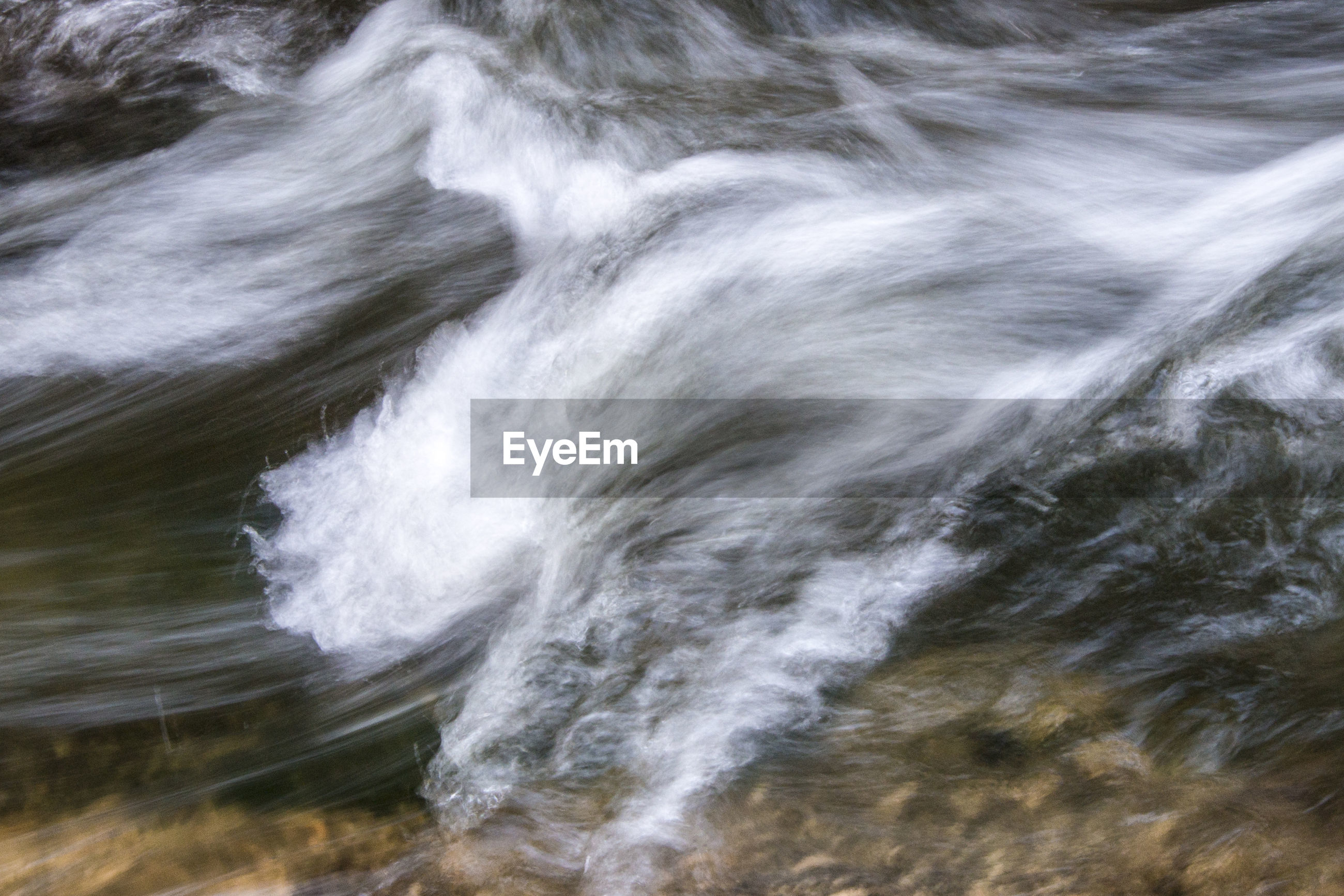 High angle view of splashing waves in stream