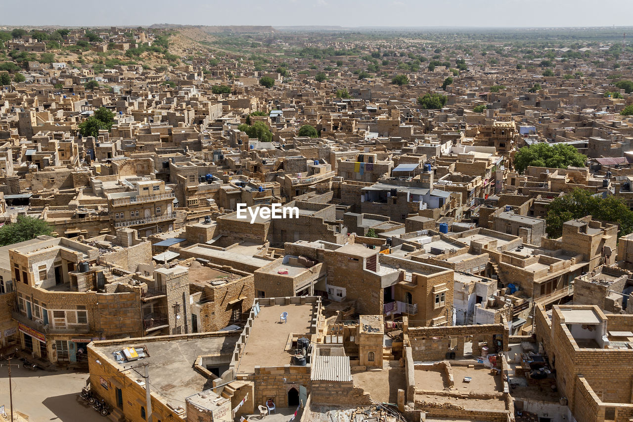 architecture, building exterior, built structure, city, high angle view, building, crowd, residential district, day, cityscape, town, nature, crowded, history, the past, outdoors, old, travel destinations, travel, townscape