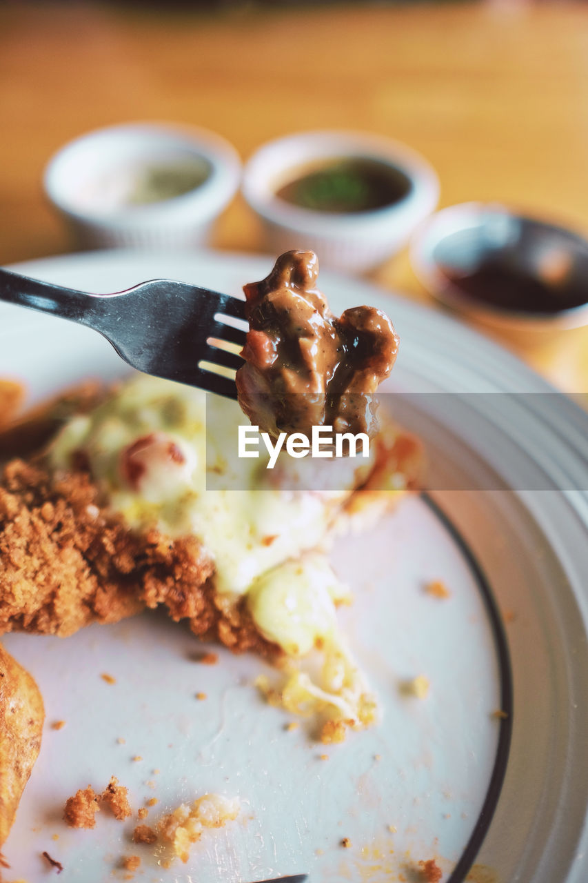 food, food and drink, kitchen utensil, eating utensil, ready-to-eat, plate, indoors, freshness, fork, close-up, table, no people, spoon, meal, focus on foreground, meat, still life, serving size, healthy eating, wellbeing, temptation, breakfast