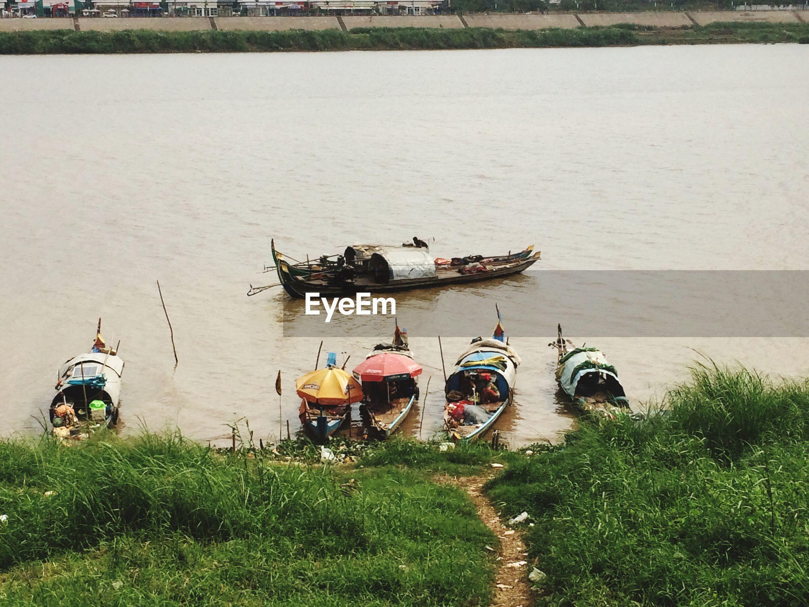 High angle view of boats at riverbank