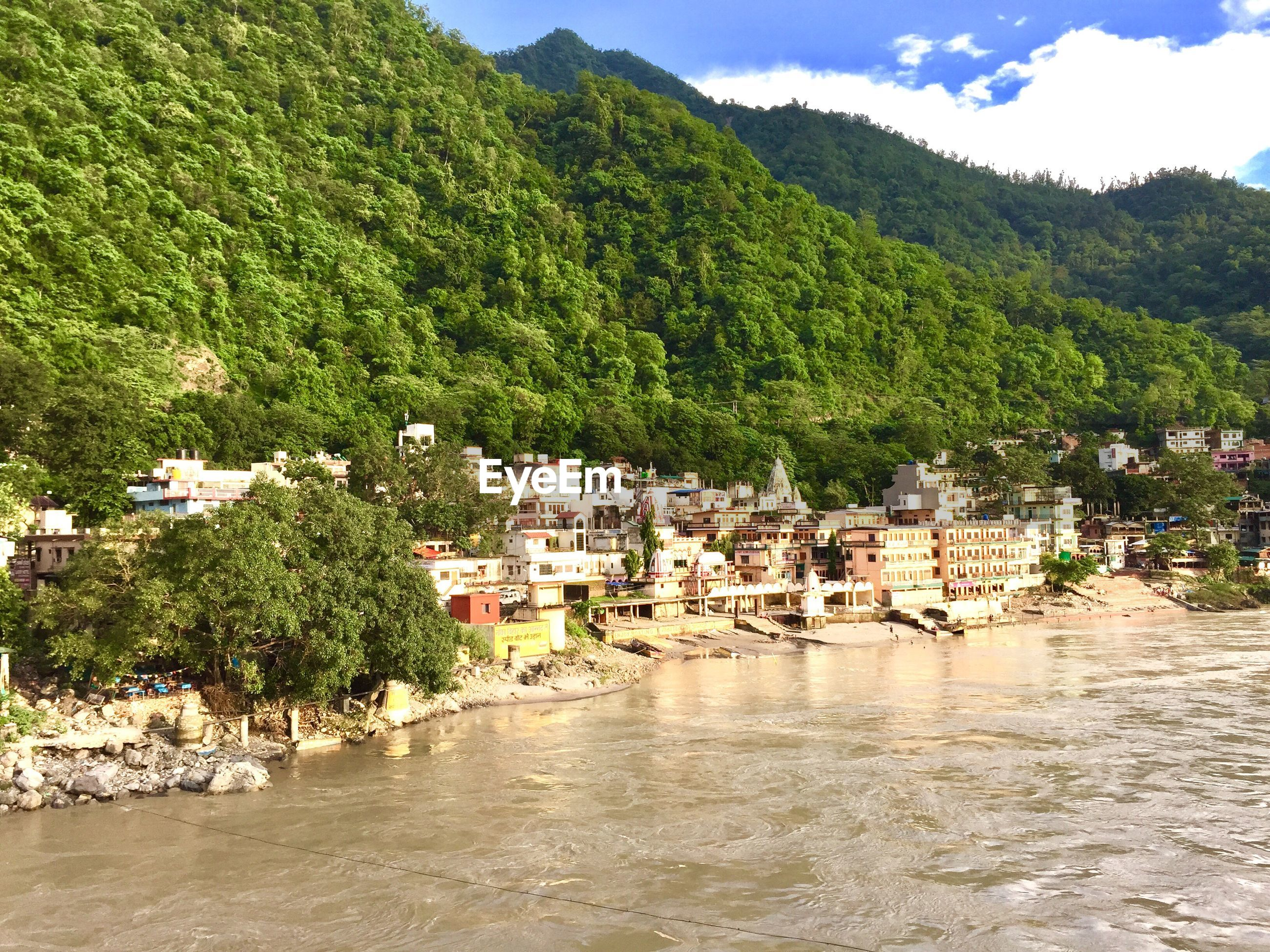 SCENIC VIEW OF RIVER BY BUILDINGS