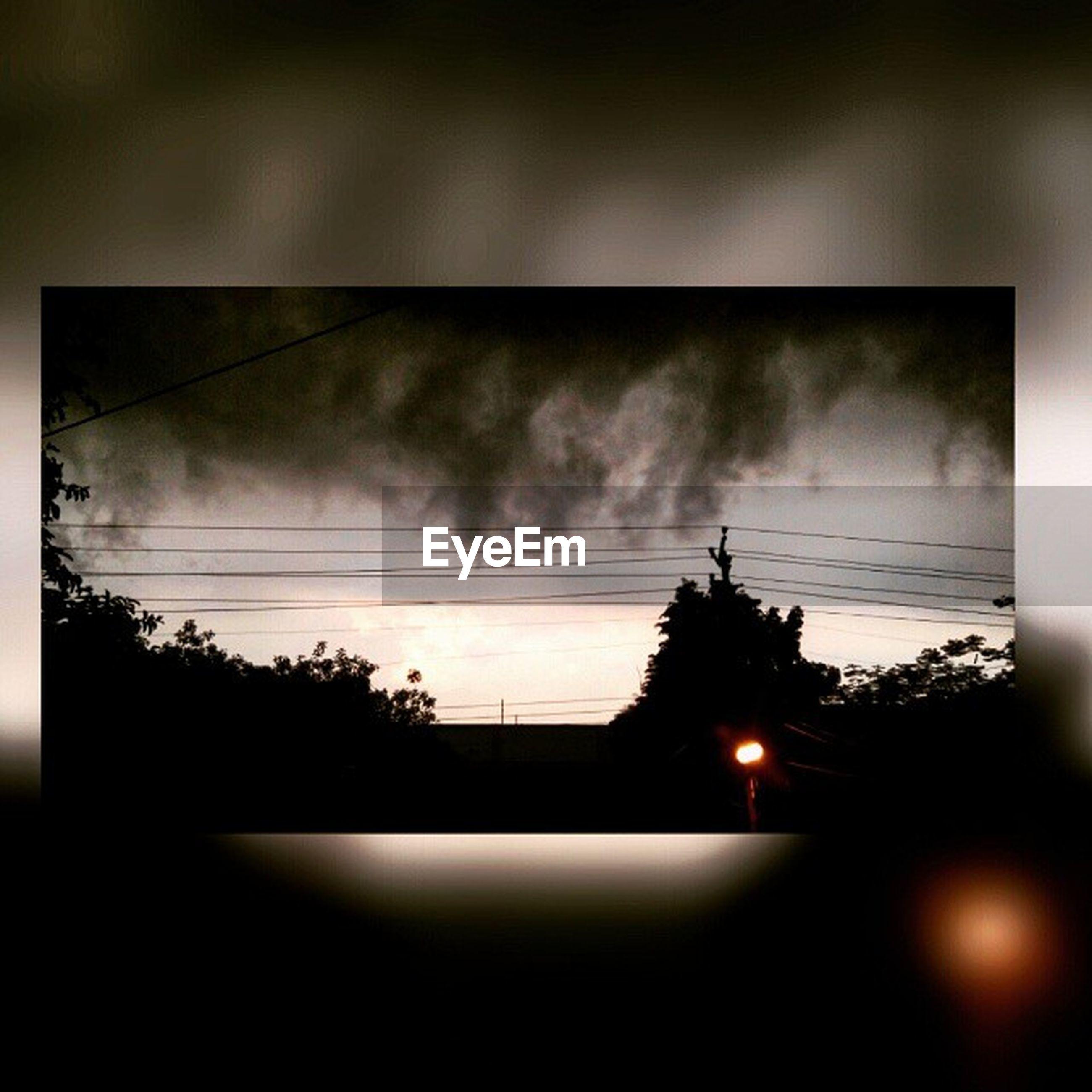 silhouette, sky, sunset, cloud - sky, power line, electricity, built structure, dusk, nature, dark, low angle view, sun, no people, window, indoors, architecture, cloud, tree, electricity pylon