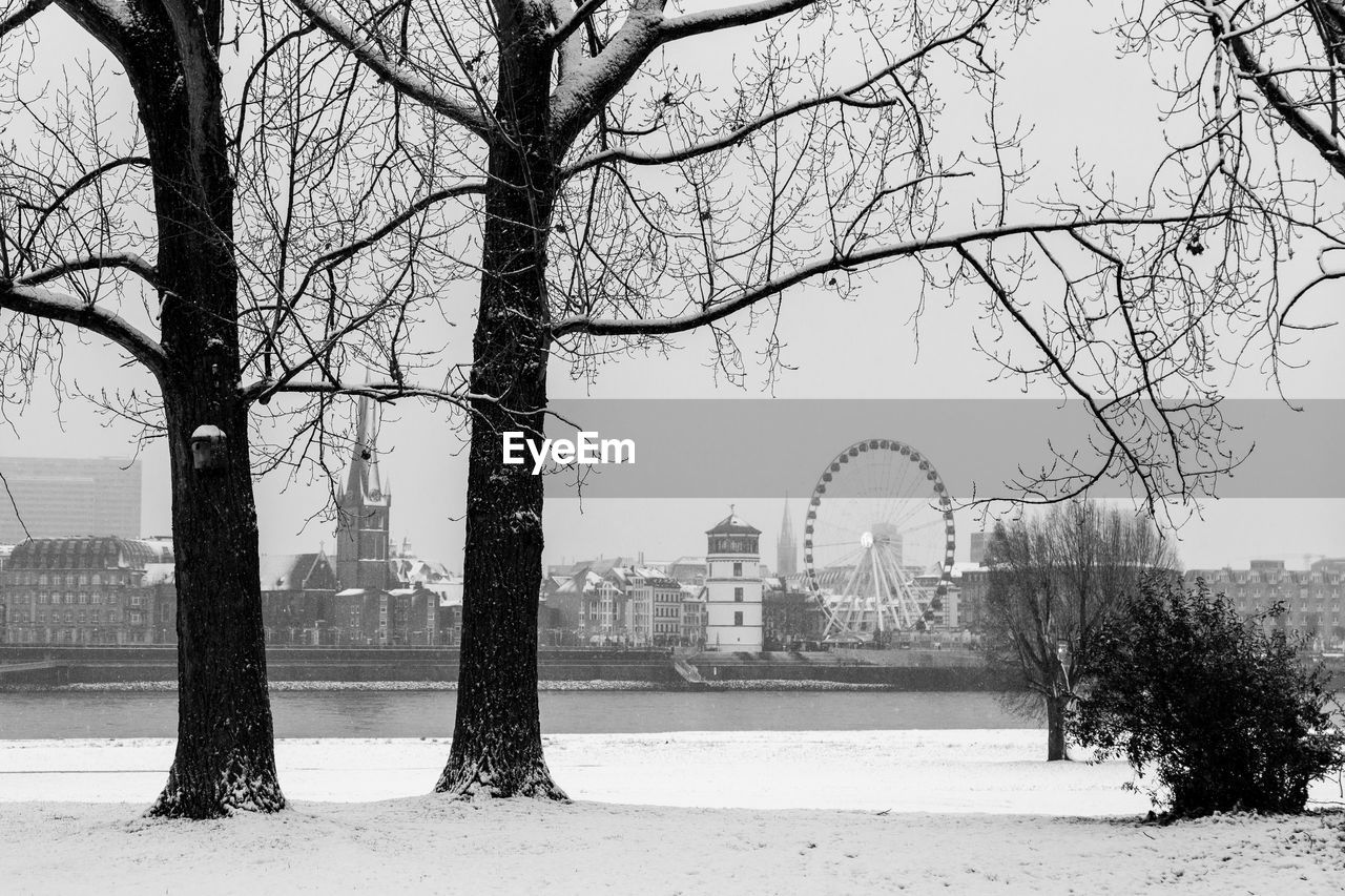 winter, tree, bare tree, snow, cold temperature, built structure, architecture, weather, travel destinations, branch, building exterior, nature, outdoors, history, day, city, no people, sky, beauty in nature