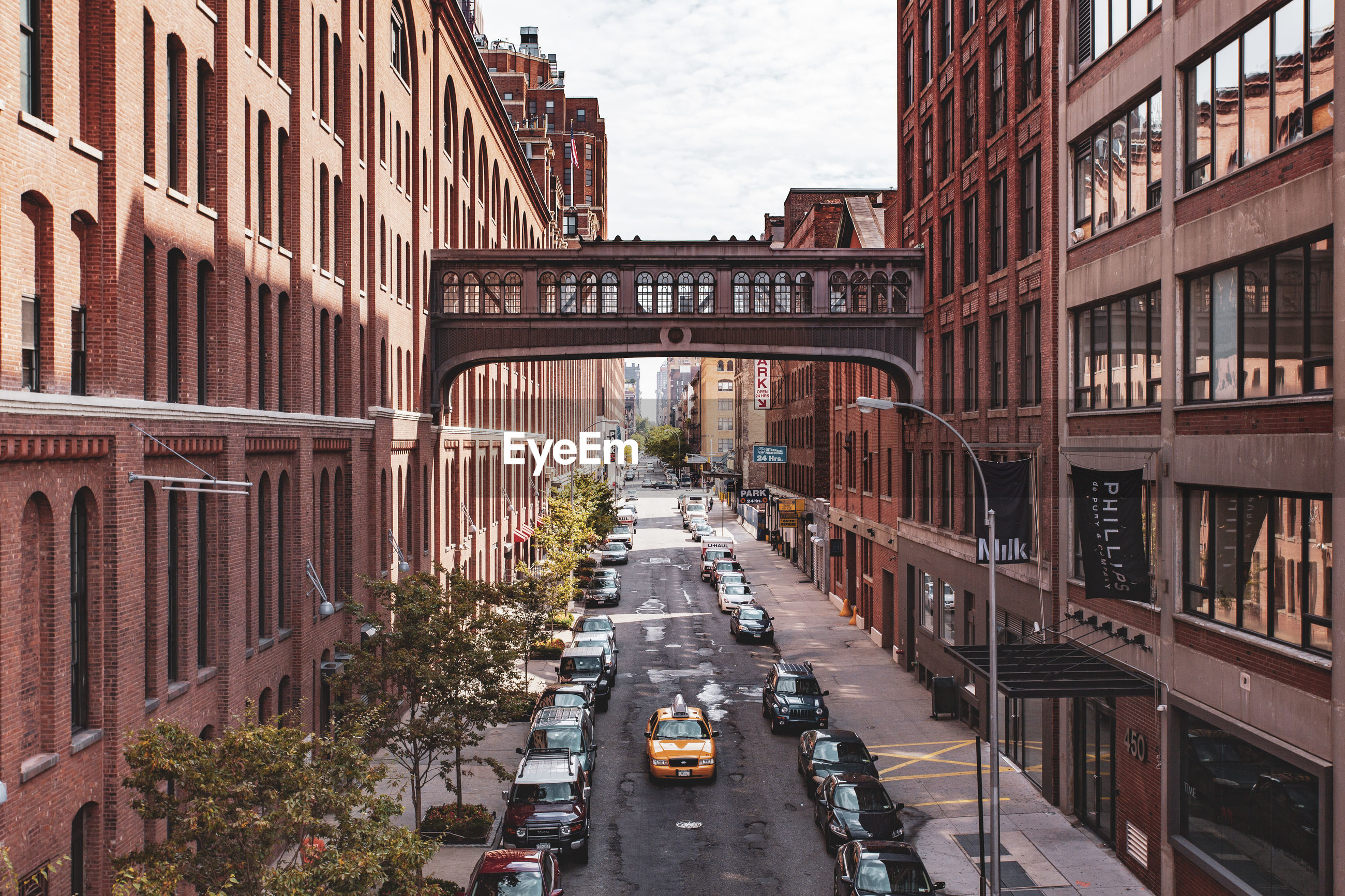 HIGH ANGLE VIEW OF BRIDGE AMIDST BUILDINGS IN CITY