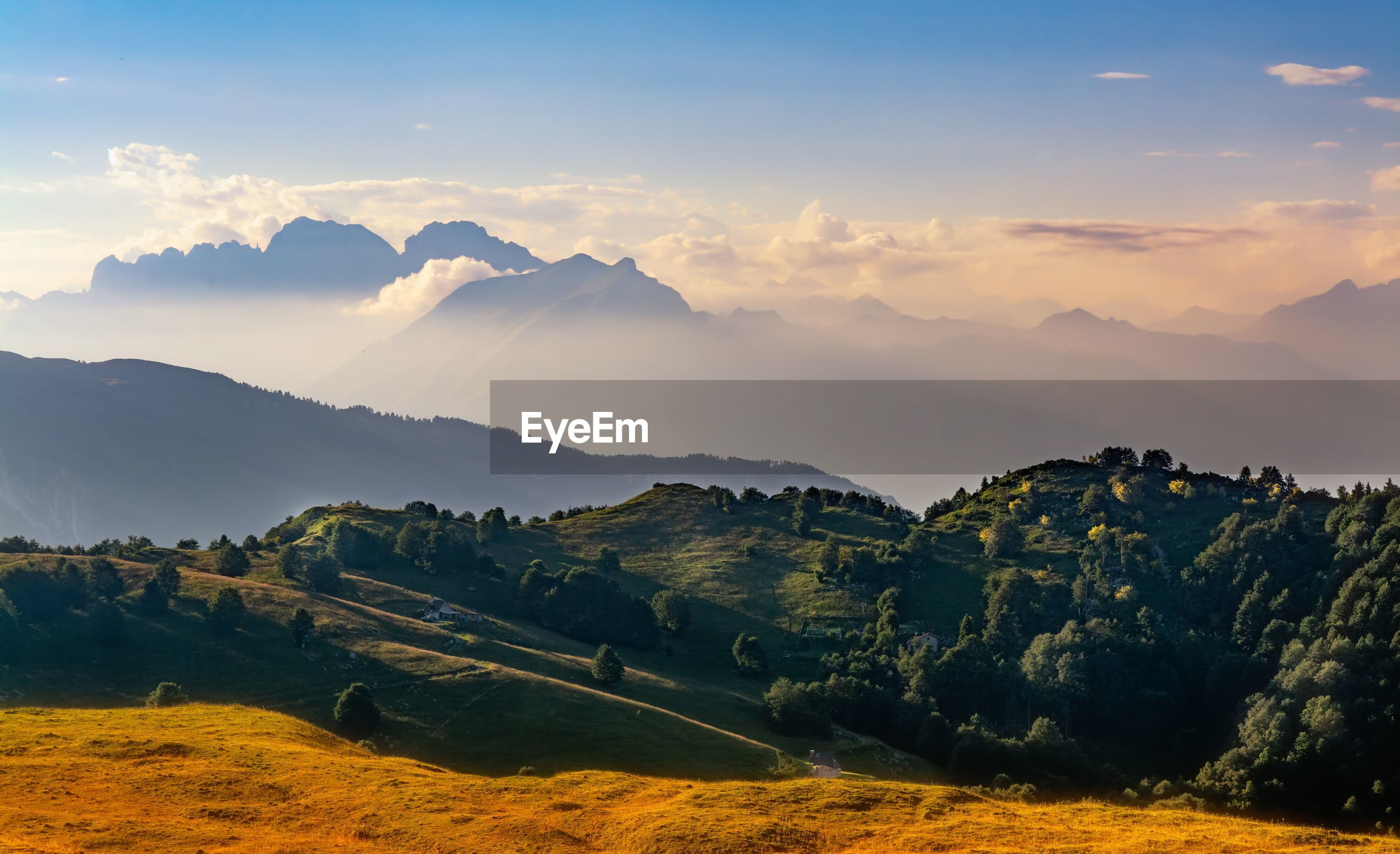 Scenic view of field against sky during sunset in mount pizzoc, veneto, italy
