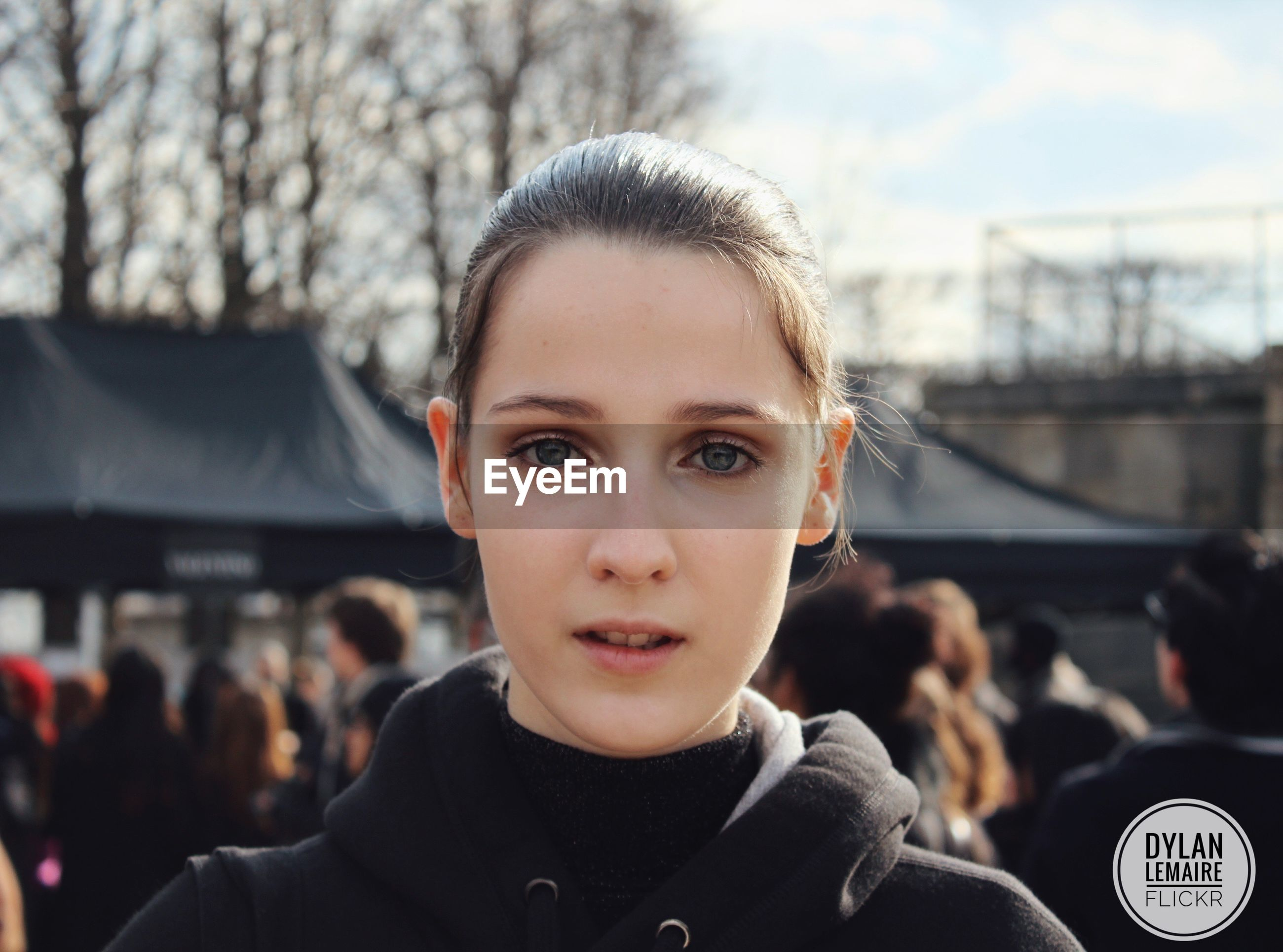 headshot, portrait, looking at camera, front view, focus on foreground, young adult, real people, one person, lifestyles, young women, close-up, leisure activity, standing, people, confidence, outdoors, day, one young woman only, beautiful woman, adult, adults only, sky, human body part