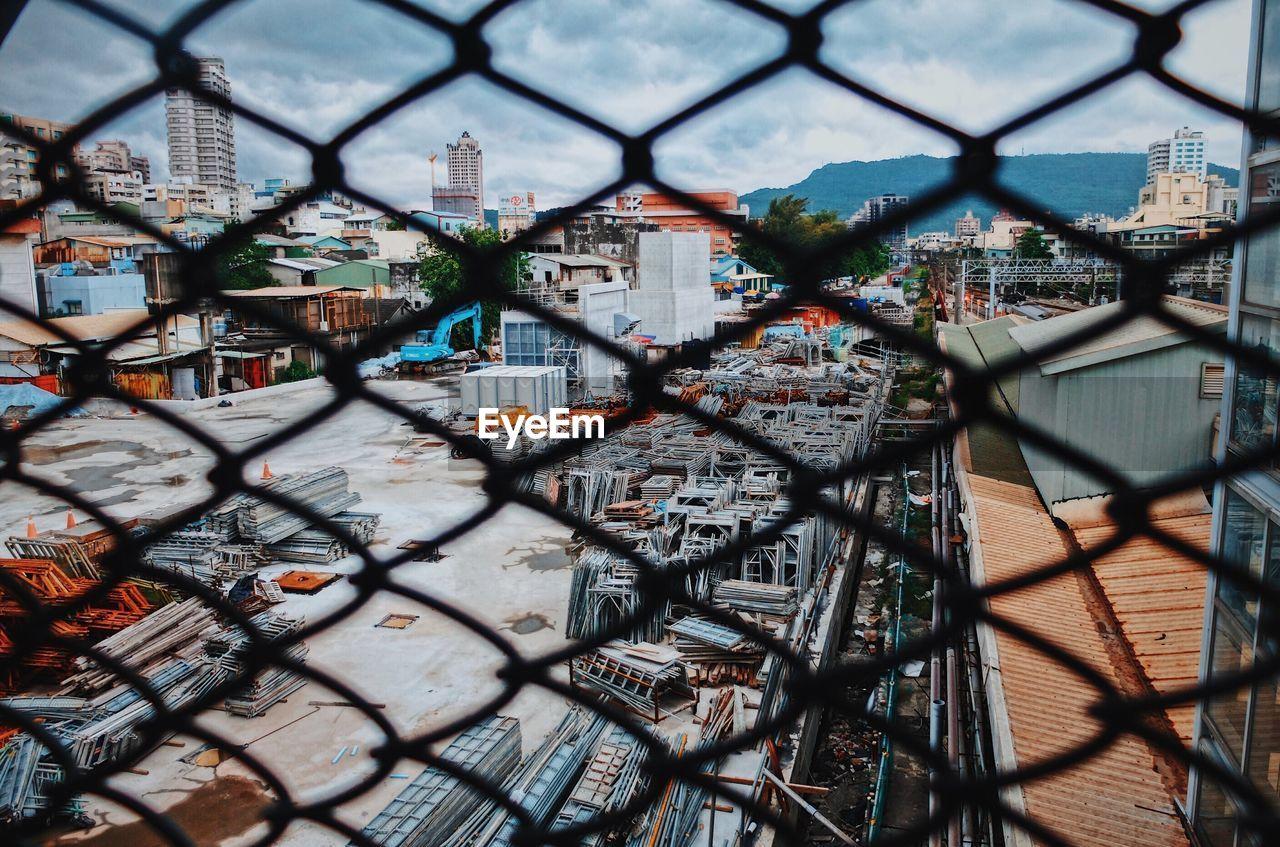 City Seen Through Metallic Window