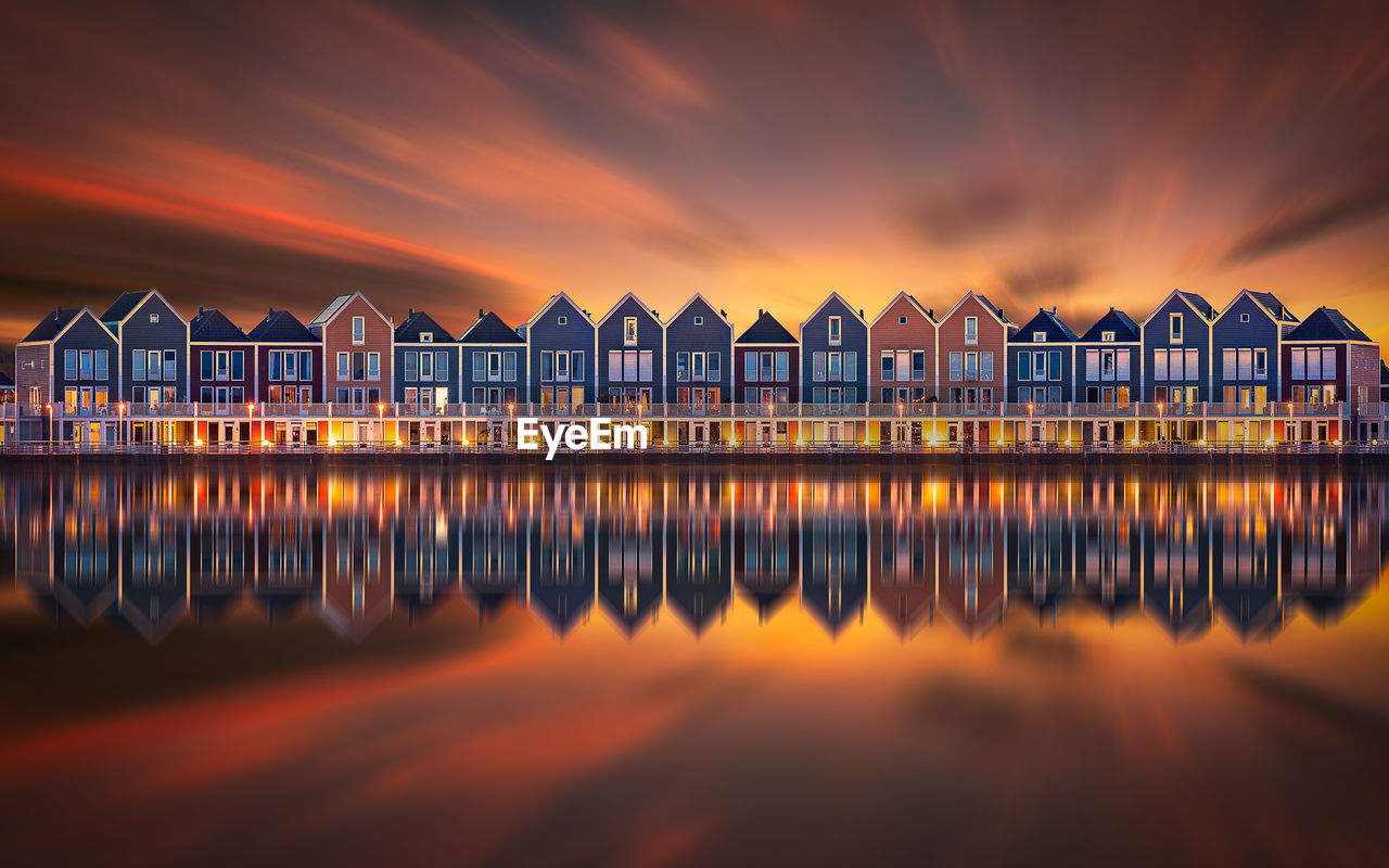 water, sunset, sky, architecture, built structure, cloud - sky, orange color, nature, no people, building exterior, sea, waterfront, reflection, scenics - nature, beauty in nature, beach, tranquility, illuminated, tranquil scene, outdoors
